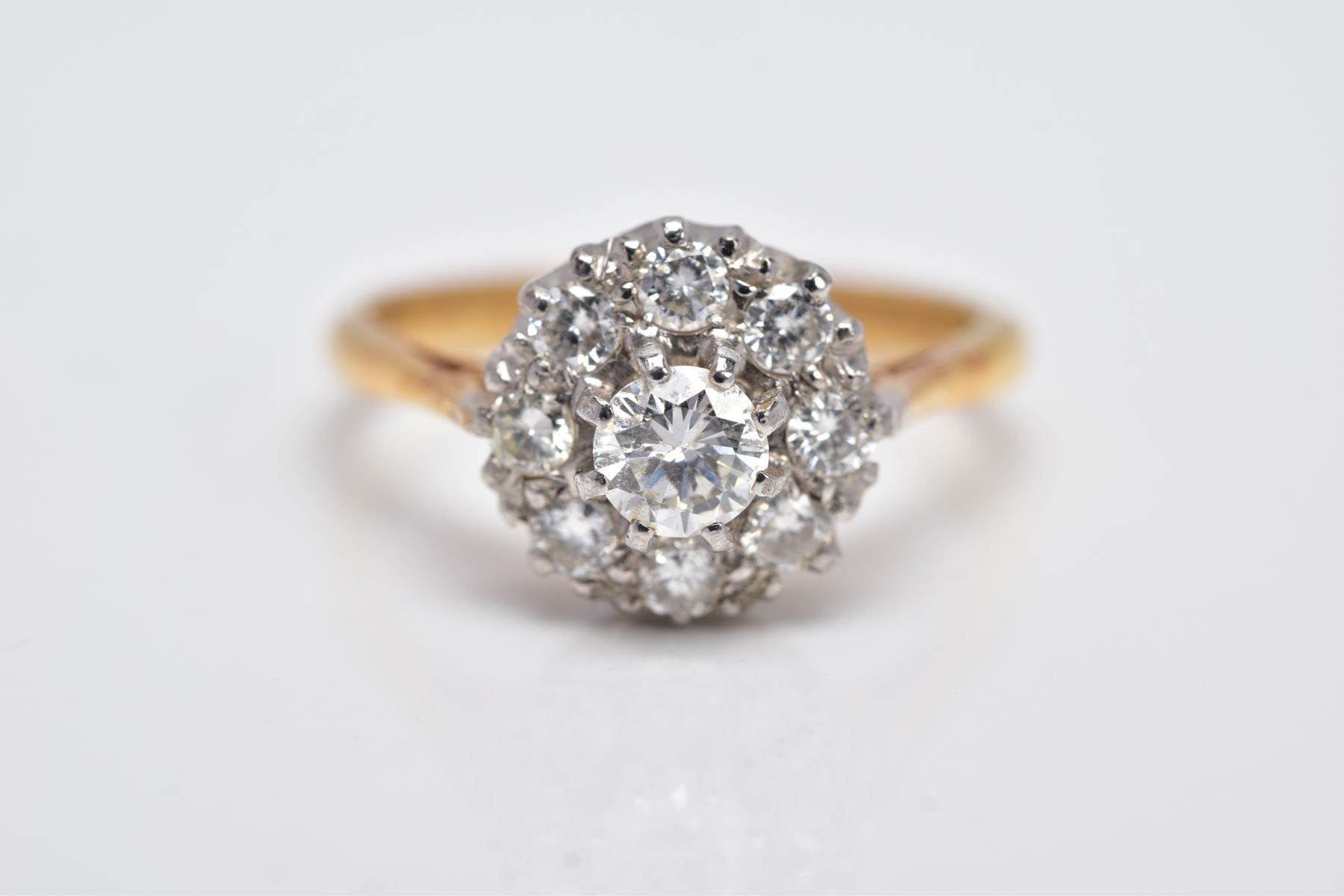 A LATE 20TH CENTURY ROUND DIAMOND CLUSTER RING, centring on a modern round brilliant cut diamond, - Image 5 of 5