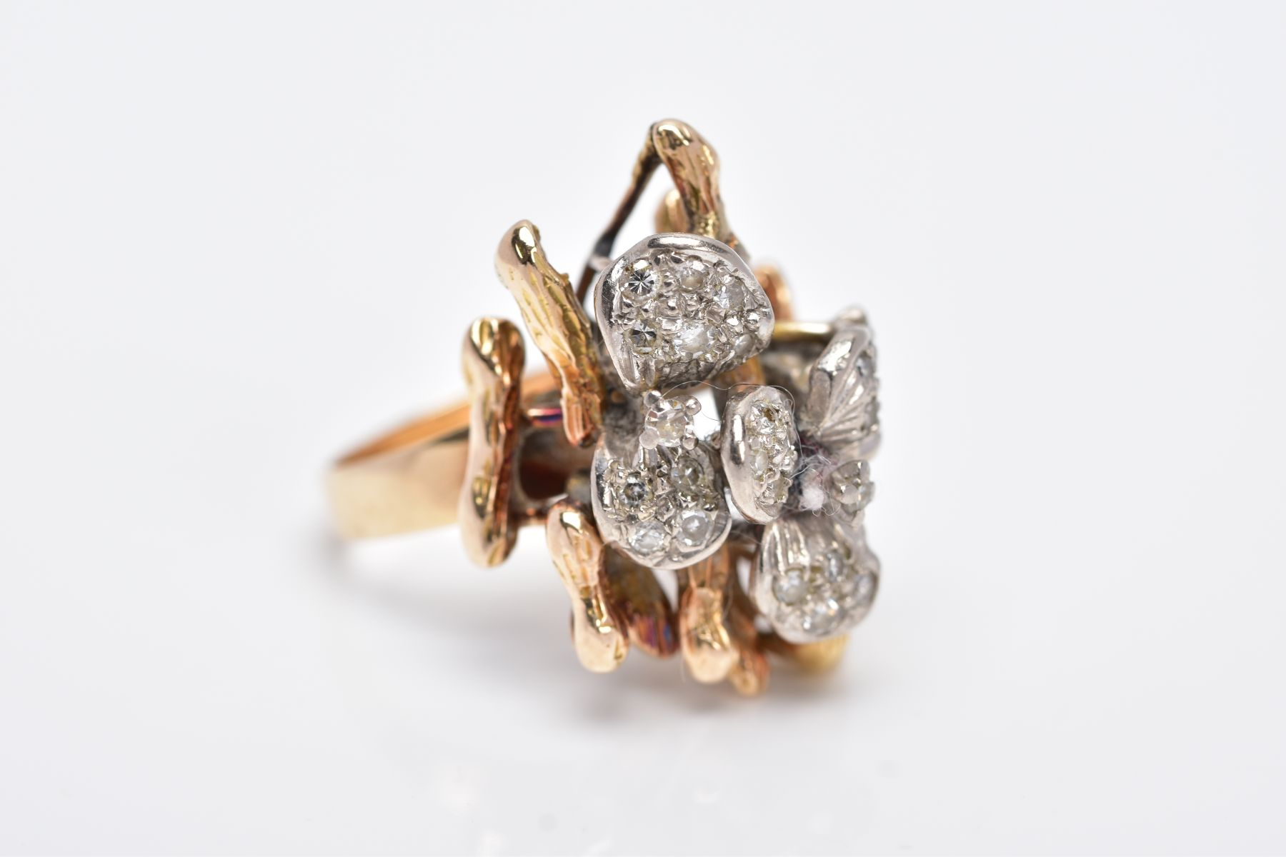 A YELLOW METAL DIAMOND SET RING, of a floral and bark textured design in the style of Andrew - Image 4 of 4