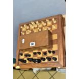 A MID 20TH CENTURY WOODEN CHESS BOARD AND CHESS PIECES, the board with lift off top opening to