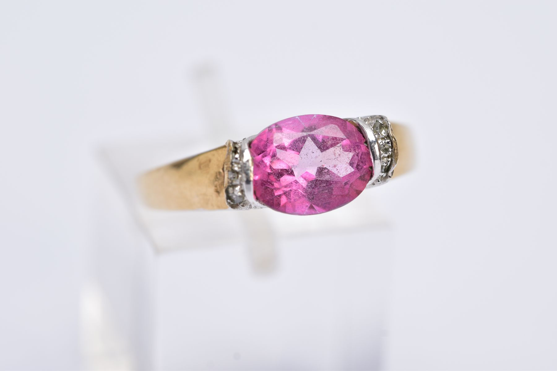 A 9CT GOLD PINK TOPAZ RING, designed with a tension set, oval cut pink topaz, single cut diamond - Image 5 of 5