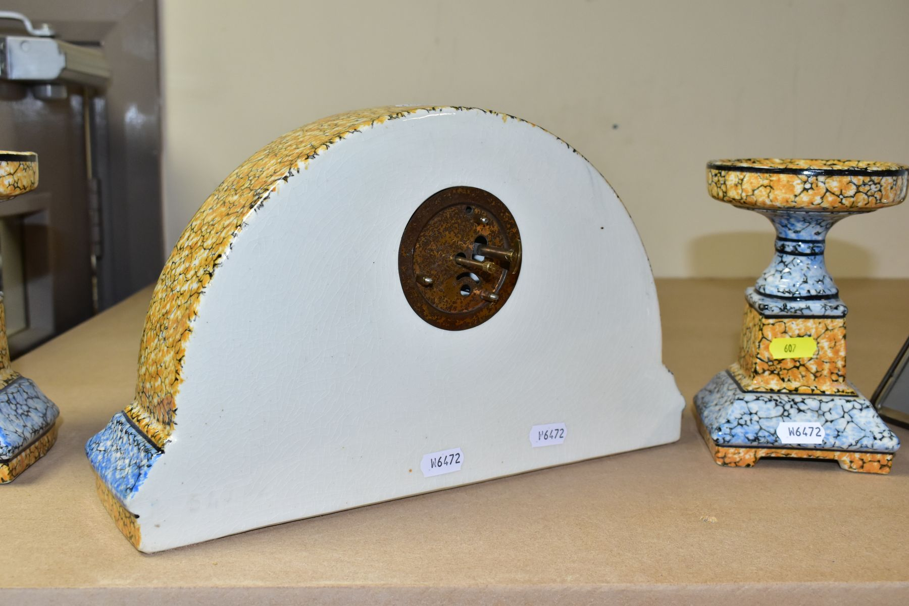 A CONTINENTAL CLOCK GARNITURE, the dome shaped porcelain clock is branded M.W inside a triangle, - Image 6 of 6