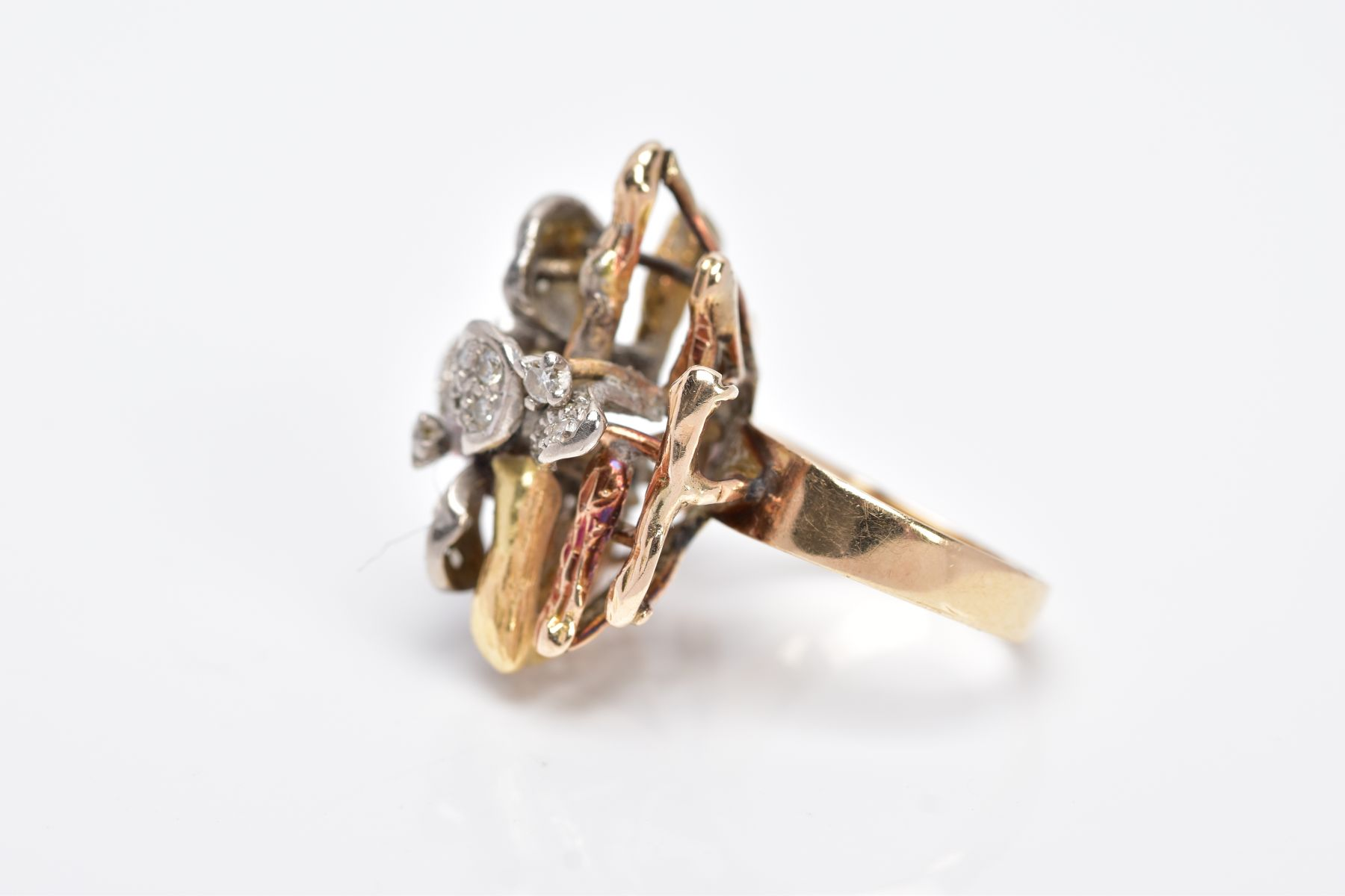 A YELLOW METAL DIAMOND SET RING, of a floral and bark textured design in the style of Andrew - Image 2 of 4