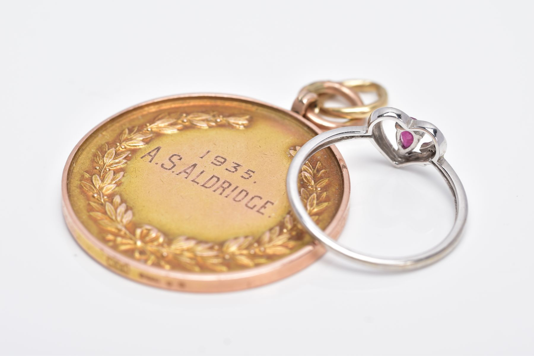 A 9CT GOLD MOUNTED MEDAL AND A 9CT WHITE GOLD RUBY AND DIAMOND RING, the medal of a circular form, - Image 4 of 4