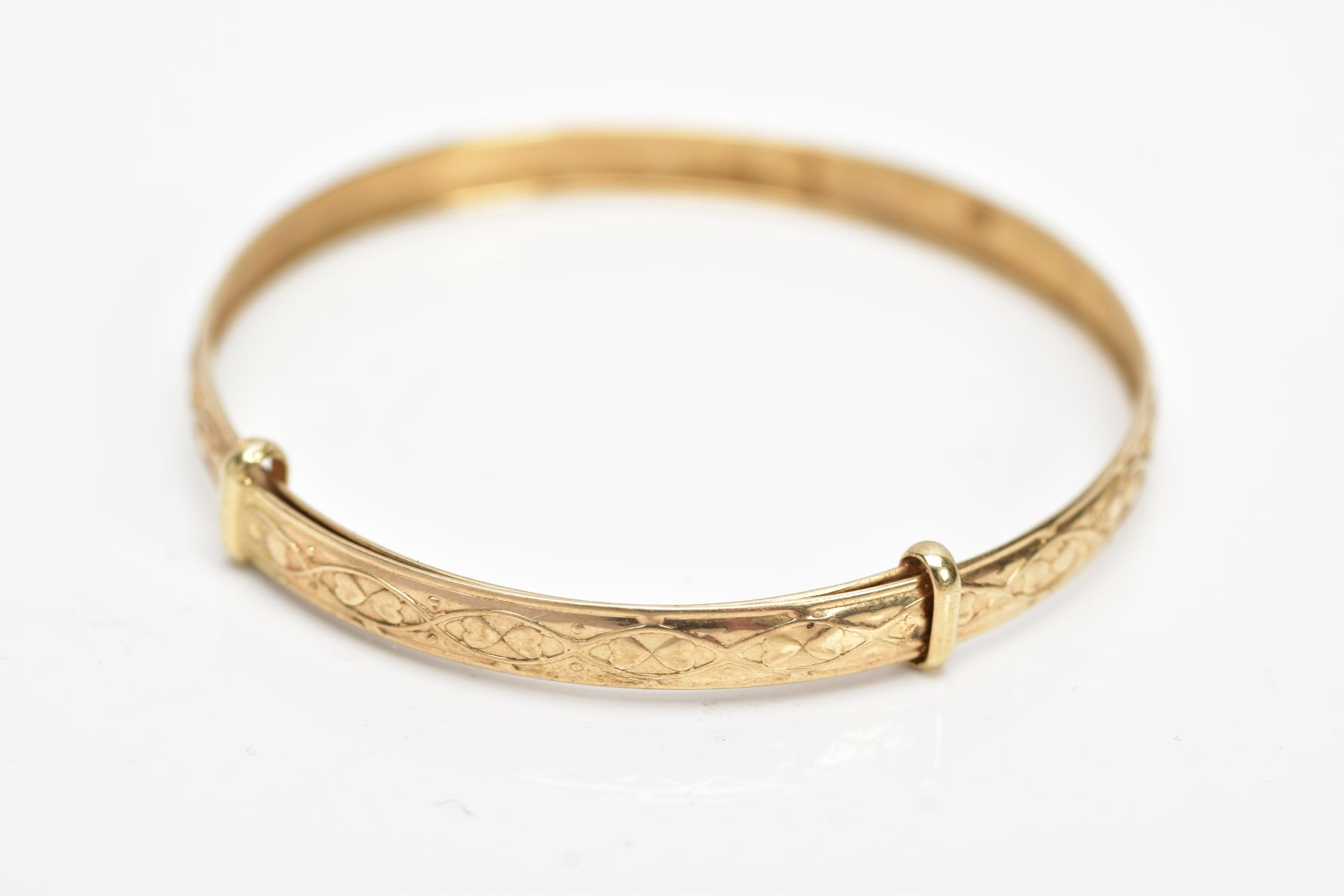 A 9CT GOLD CHRISTENING BANGLE, embossed heart and scroll design, hallmarked 9ct gold Birmingham, - Image 2 of 3