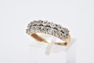 A 9CT GOLD DIAMOND RING, designed with two rows of illusion set, round brilliant cut diamonds,