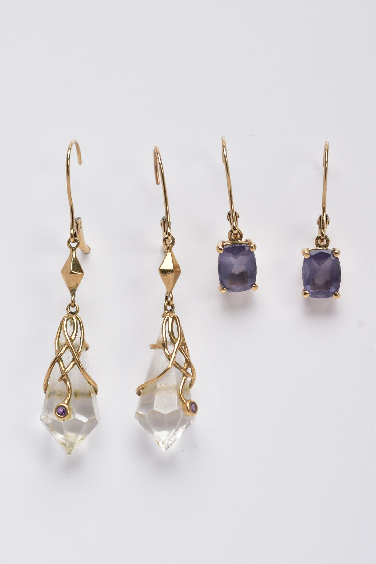 TWO PAIRS OF YELLOW METAL GEMSET DROP EARRINGS, the first pair suspending claw set, oval cut