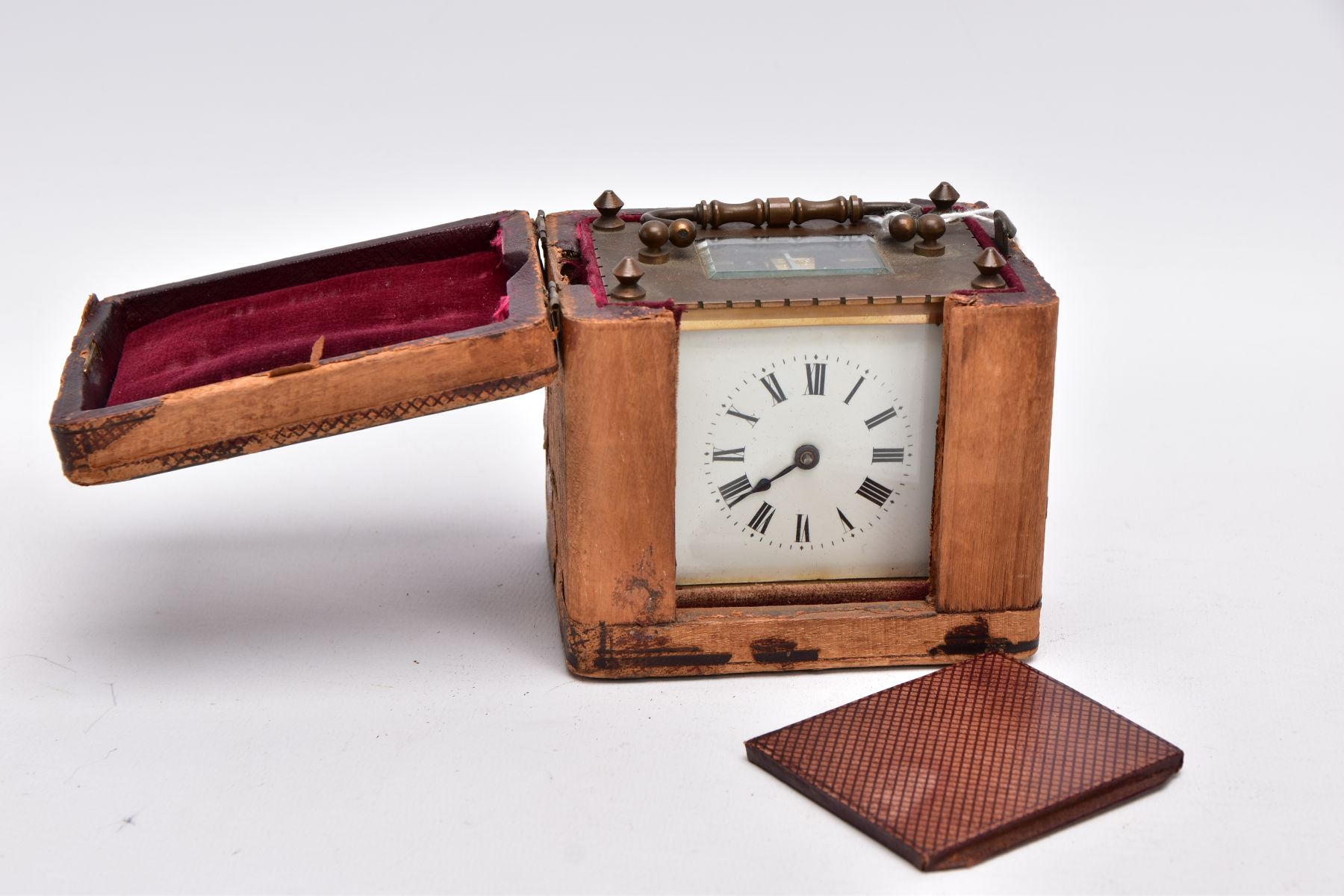 A SMALL LEATHER CASED BRASS TRAVEL CARRIAGE CLOCK, glass panels, white dial with roman numerals, - Image 7 of 8