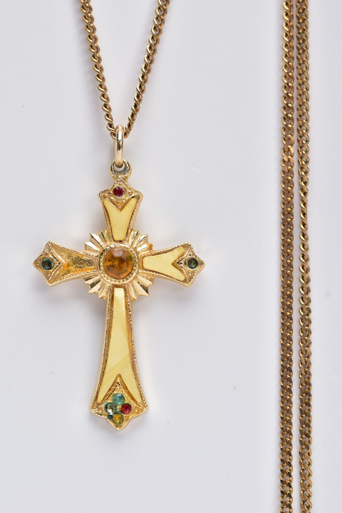 A 9CT GOLD CHAIN WITH A YELLOW METAL CROSS PENDANT, the curb link chain fitted with a spring