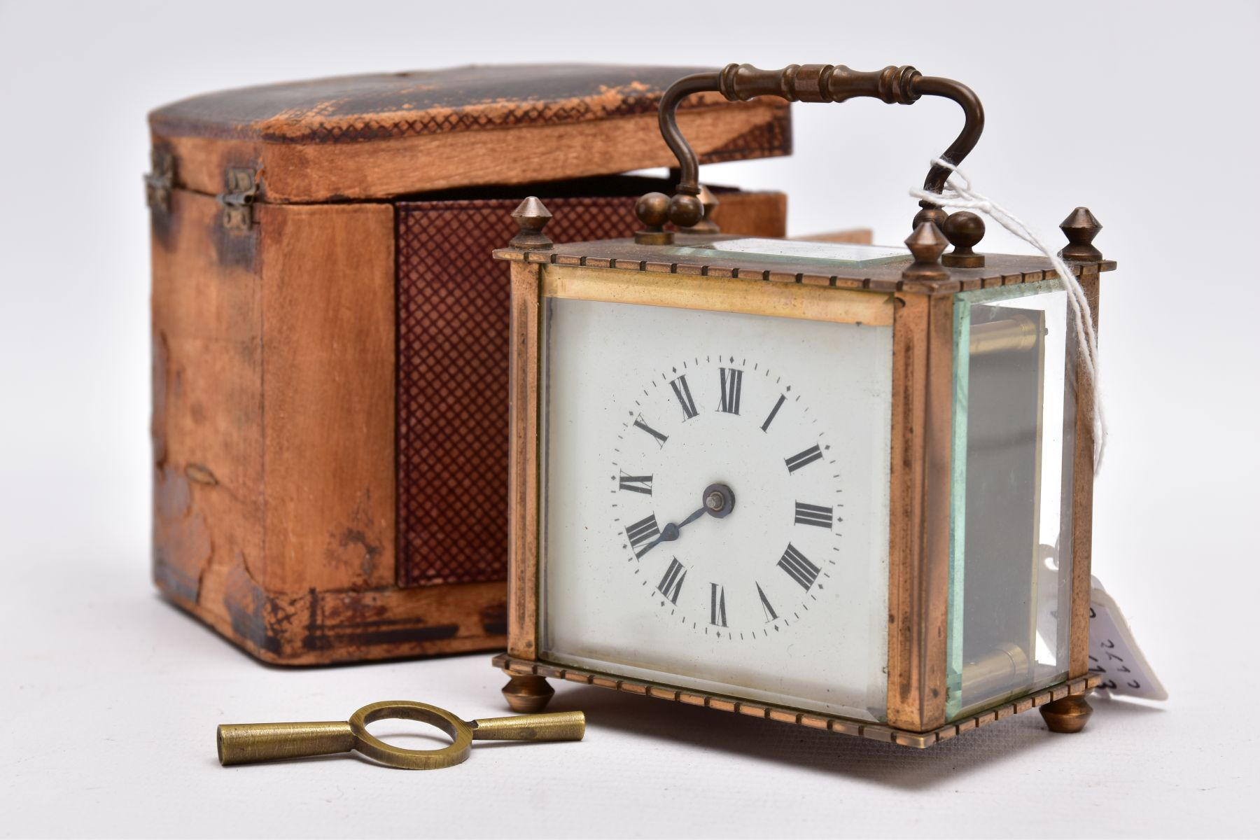 A SMALL LEATHER CASED BRASS TRAVEL CARRIAGE CLOCK, glass panels, white dial with roman numerals, - Image 5 of 8