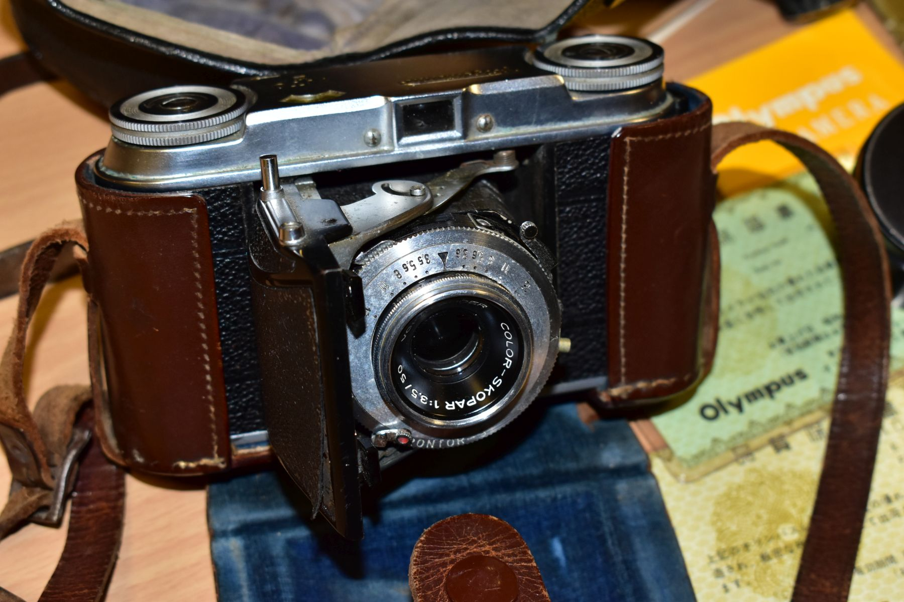 AN ORIGINAL OLYMPUS F HALF FRAME FILM CAMERA fitted with a 38mm f1.8 Olympus Zuiko lens and F T - Image 2 of 11