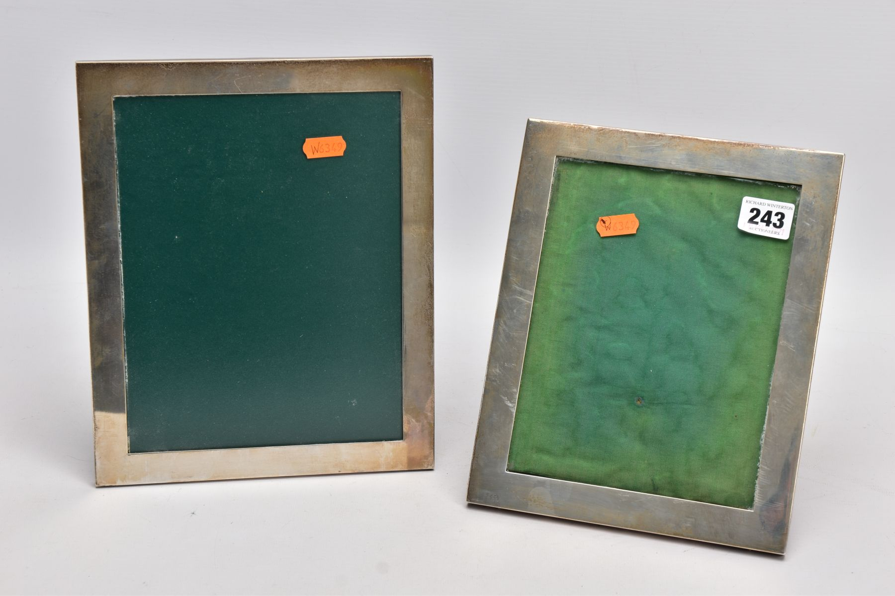 TWO SILVER PHOTO FRAMES, each of a rectangular form, the largest measuring approximately 26cm x