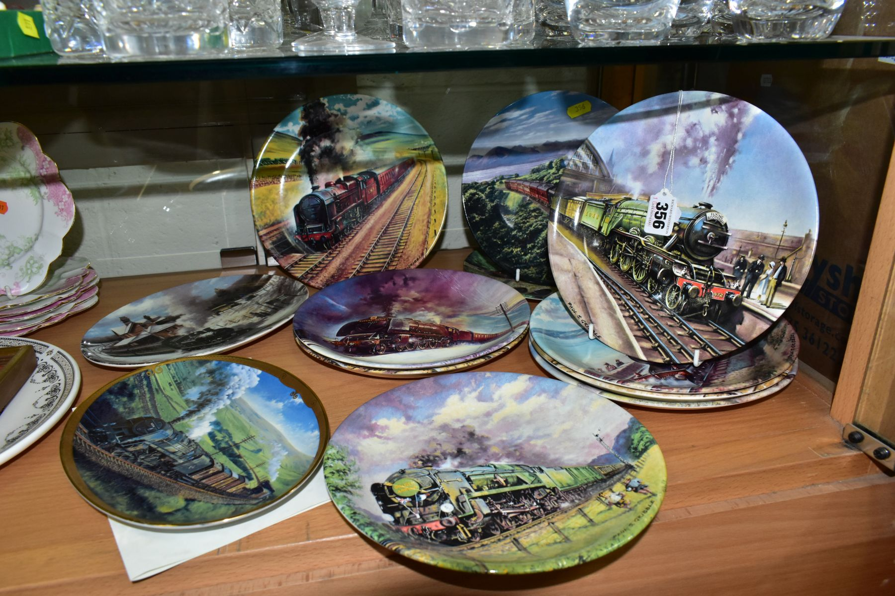 TWELVE BOXED LOCOMOTIVE THEMED COLLECTORS PLATES, comprising a set of eight Davenport Great Steam