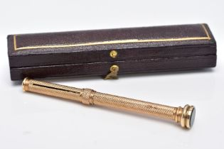A YELLOW METAL PROPELLING PENCIL, engine turn design, set with a bloodstone terminal, approximate