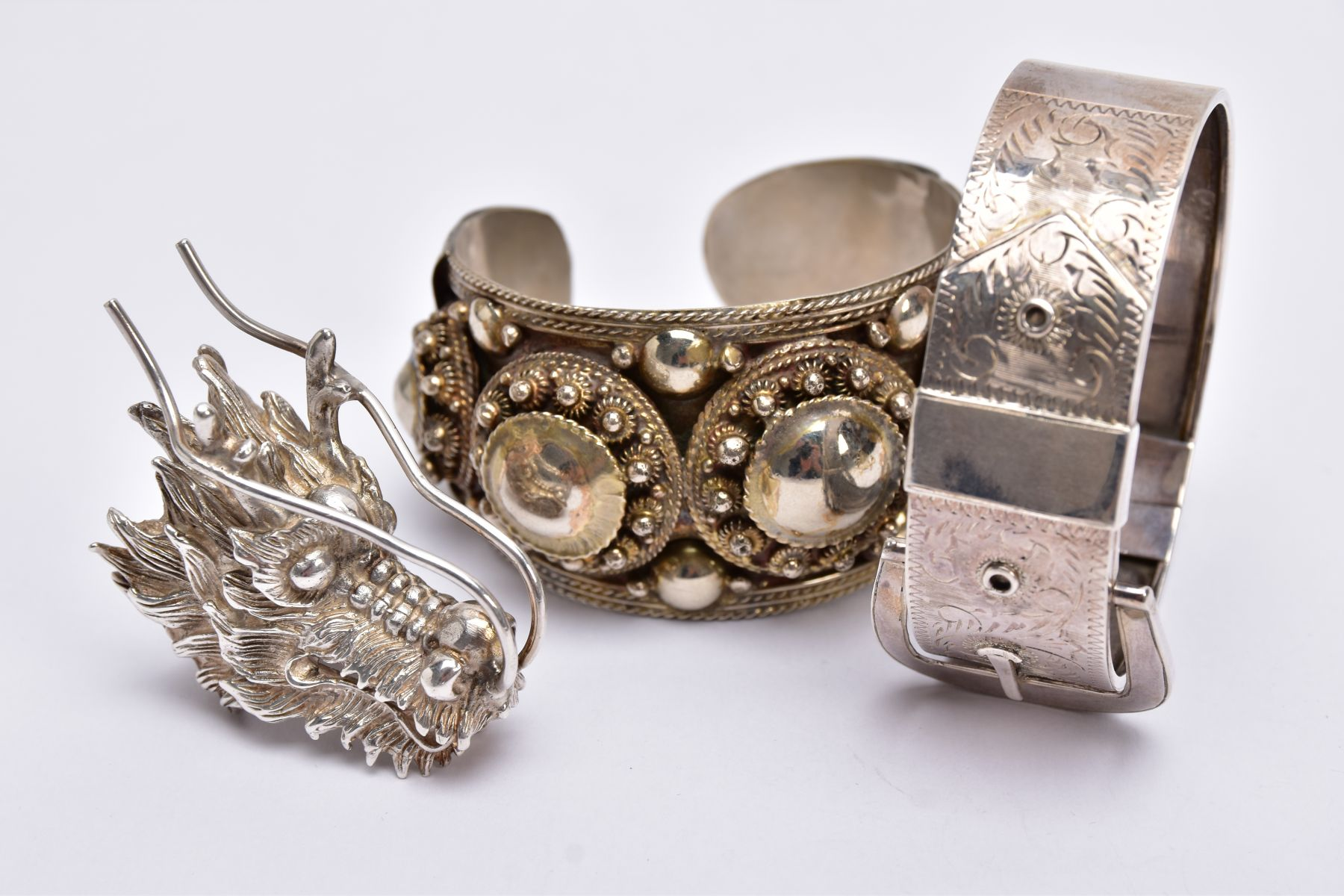 A WHITE METAL BANGLE, CUFF BANGLE AND A RING, the hinged bangle of a belt and buckle design, foliate - Image 5 of 5