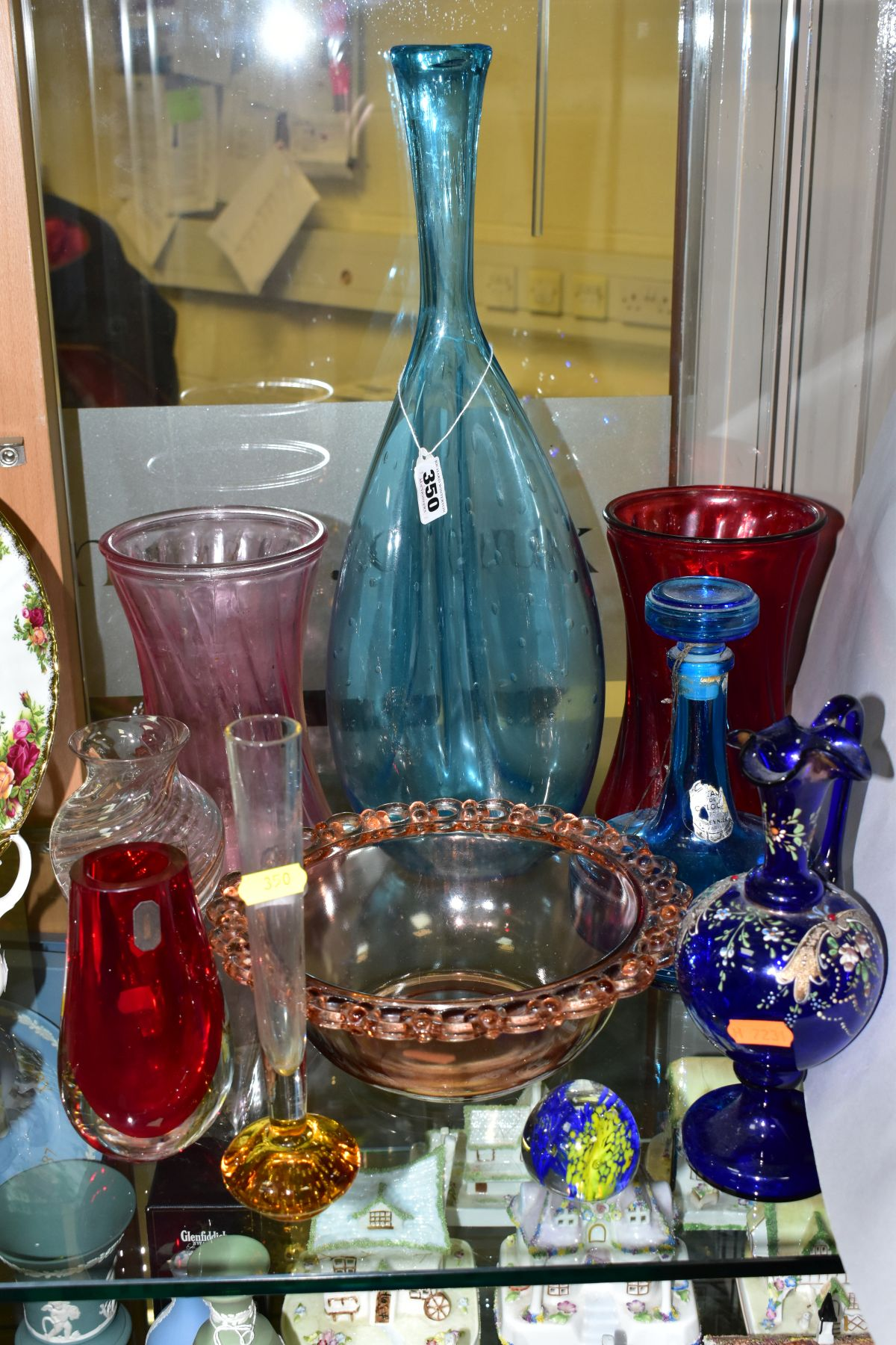 TEN PIECES OF COLOURED GLASSWARE including a blue glass vase of triform shape, with bubble