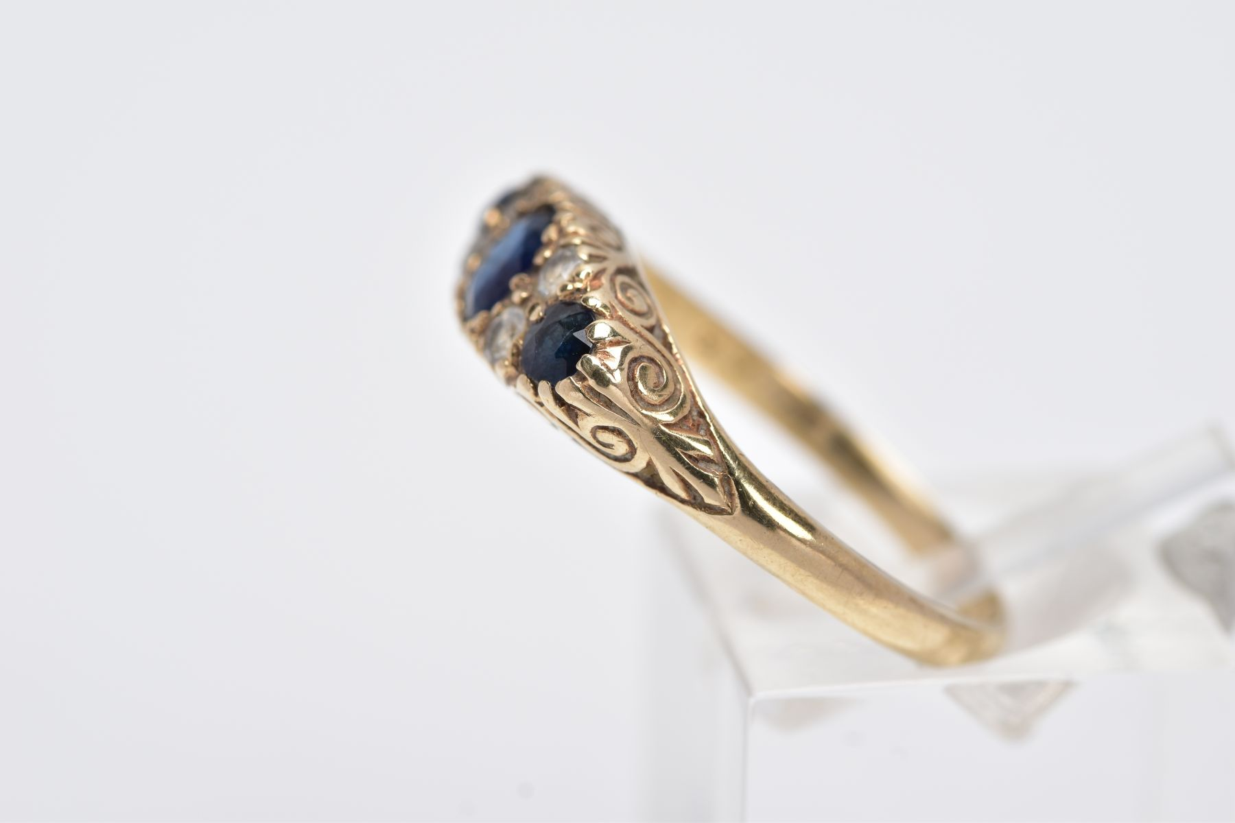 A 9CT GOLD SAPPPHIRE AND PASTE RING, centring on an oval cut blue sapphire flanked with colourless - Image 2 of 4