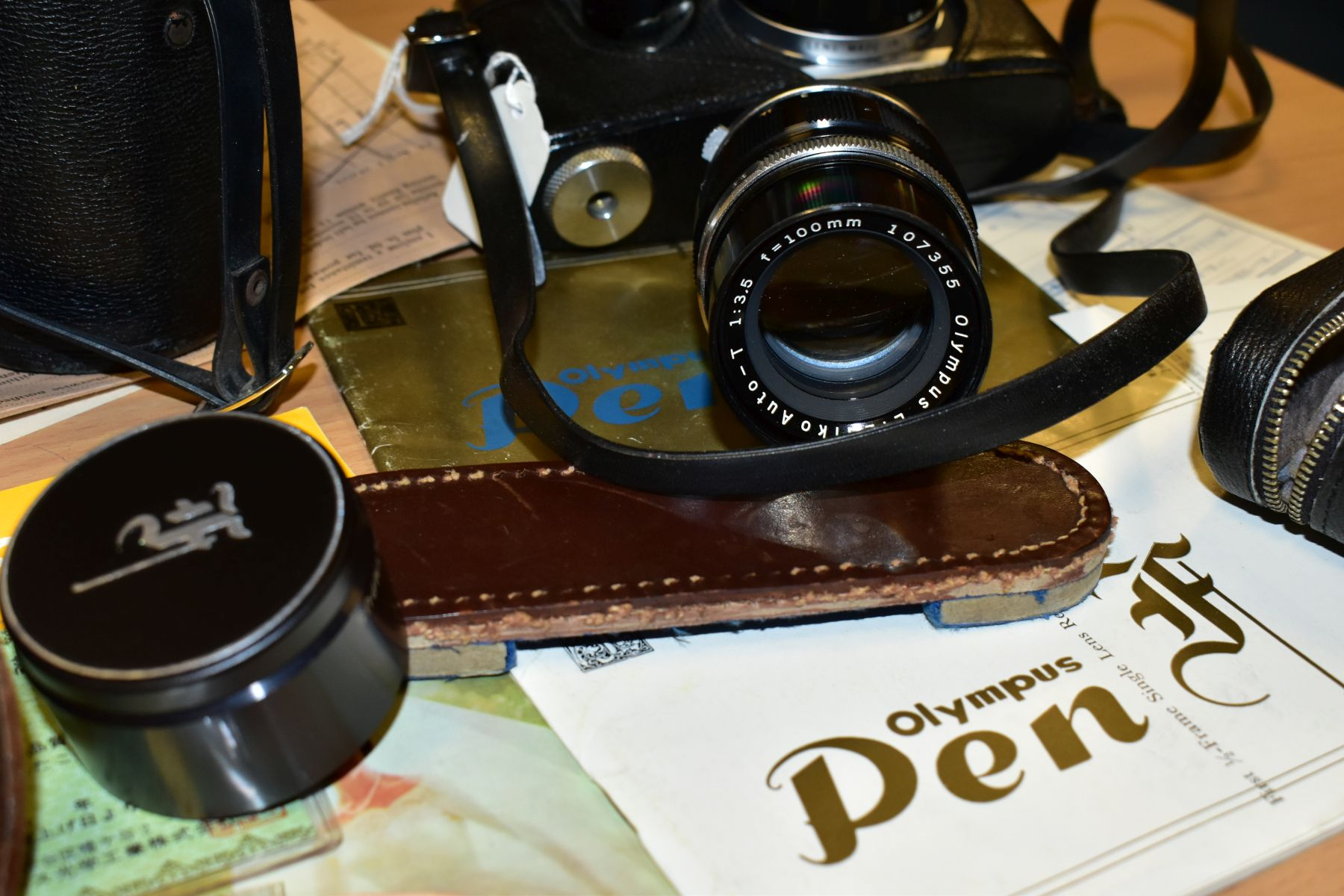 AN ORIGINAL OLYMPUS F HALF FRAME FILM CAMERA fitted with a 38mm f1.8 Olympus Zuiko lens and F T - Image 5 of 11