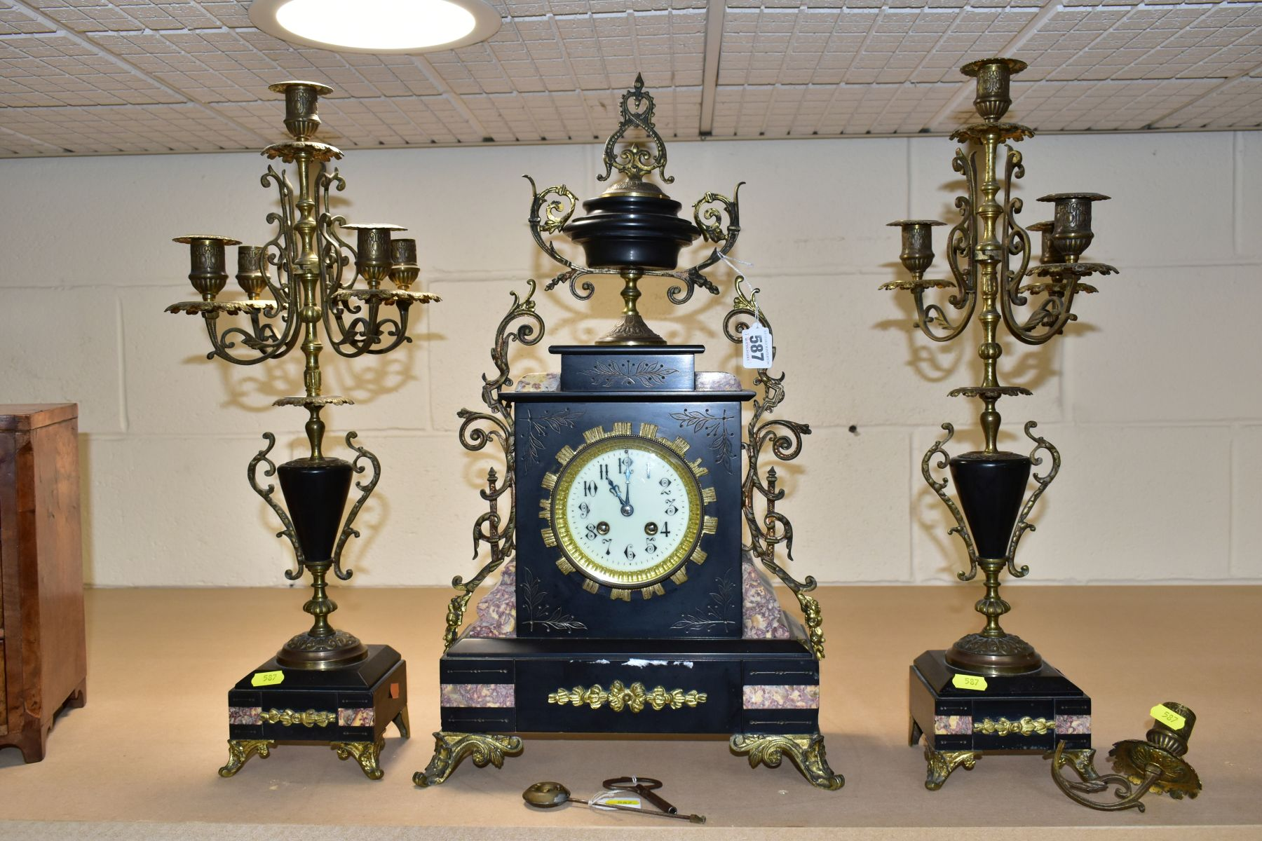 A LATE 19TH CENTURY BLACK SLATE, MARBLE AND GILT METAL CLOCK GARNITURE, the clock with urn shaped