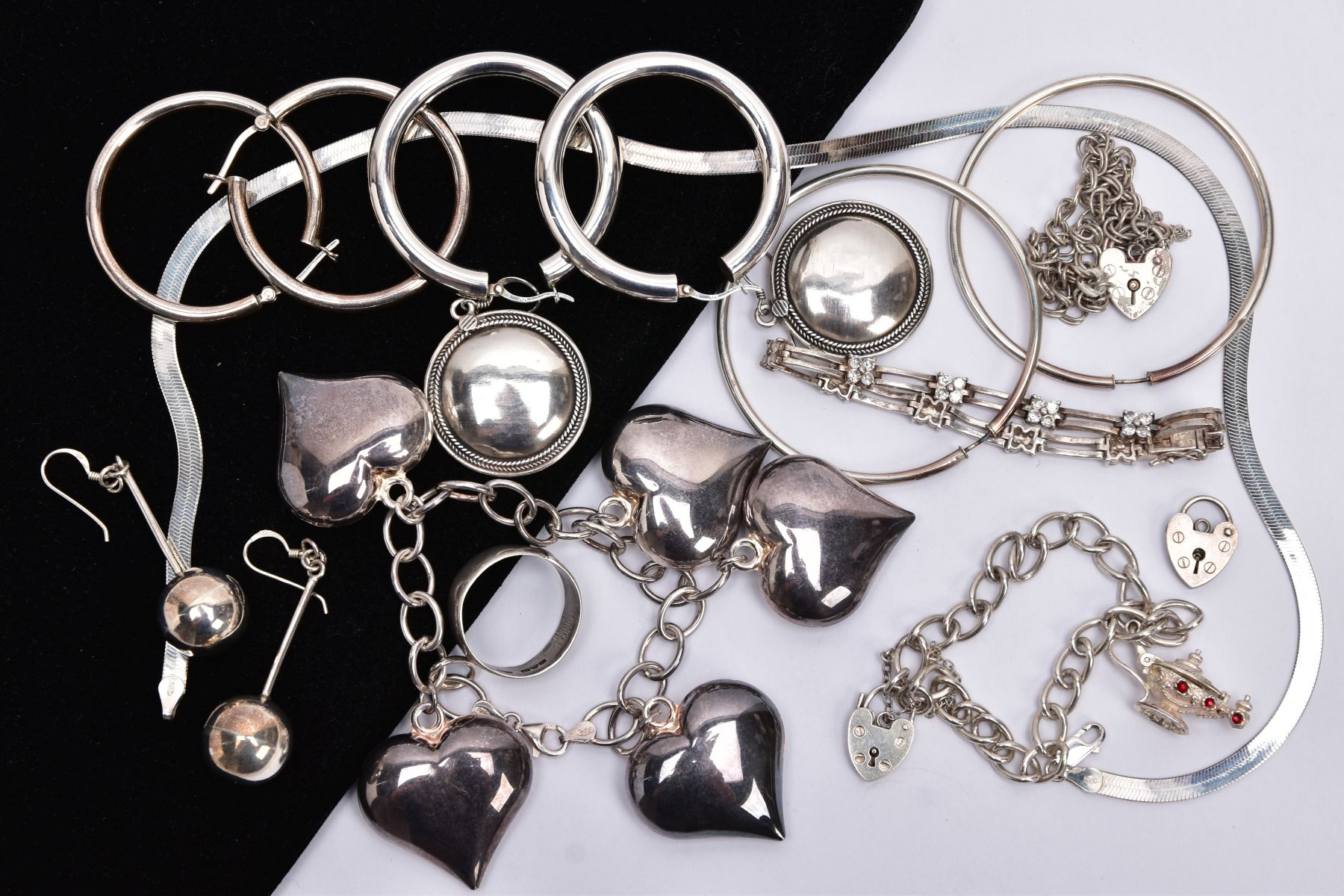 A BAG OF ASSORTED SILVER AND WHITE METAL JEWELLERY, to include a silver charm bracelet suspending