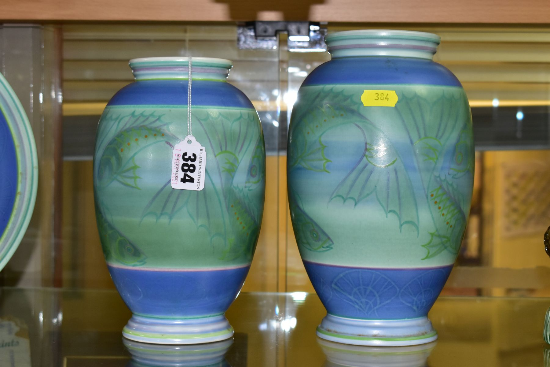 A POOLE STUDIO SALLY TUFFIN BALUSTER VASE AND MATCHING JAR, the baluster vase handpainted with bands