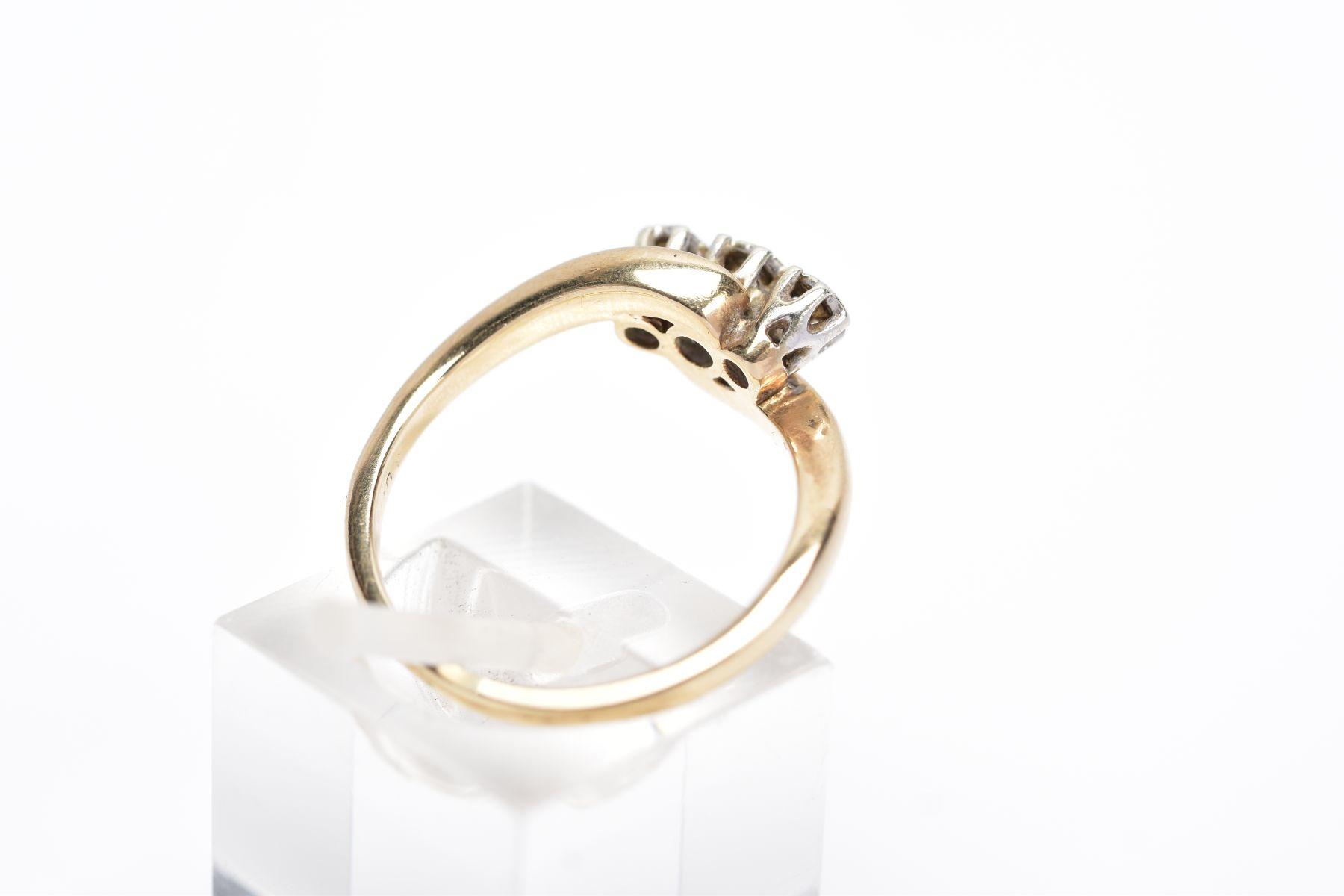 A 9CT GOLD THREE STONE DIAMOND RING, designed with three graduated round brilliant cut diamonds, - Image 3 of 4