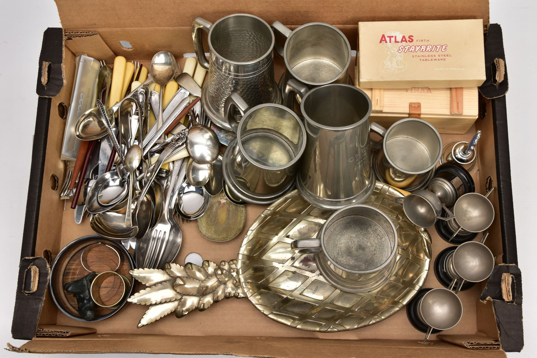 A BOX OF WHITE METALWARE, to include five pint sized pewter tankards, a half pint sized pewter