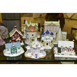 NINE COALPORT FINE BONE CHINA COTTAGES/BUILDINGS, comprising 'The Parasol House' (several flowers