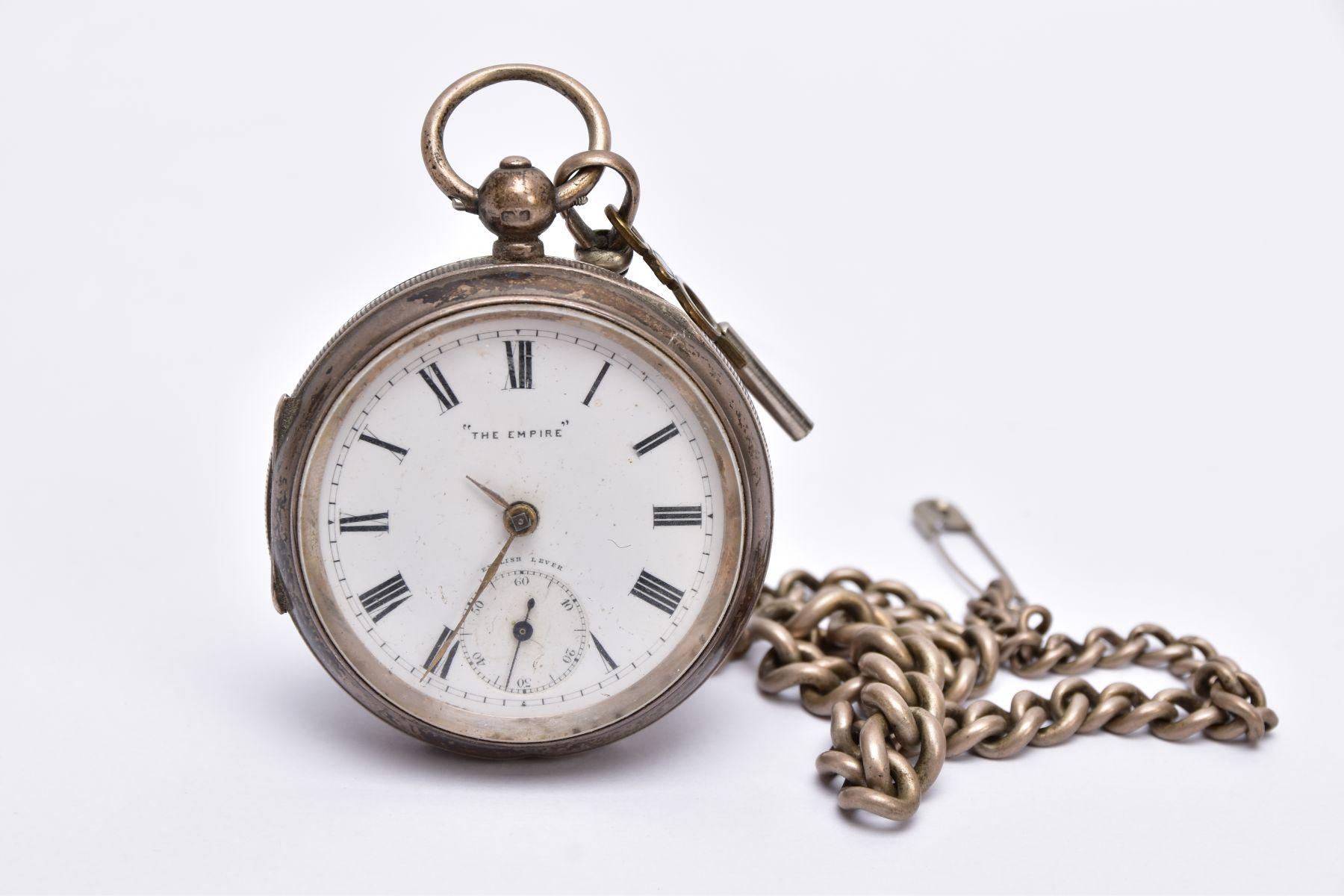 A SILVER OPEN FACED POCKET WITH ALBERT CHAIN, white dial signed 'The Empire', Roman numerals,