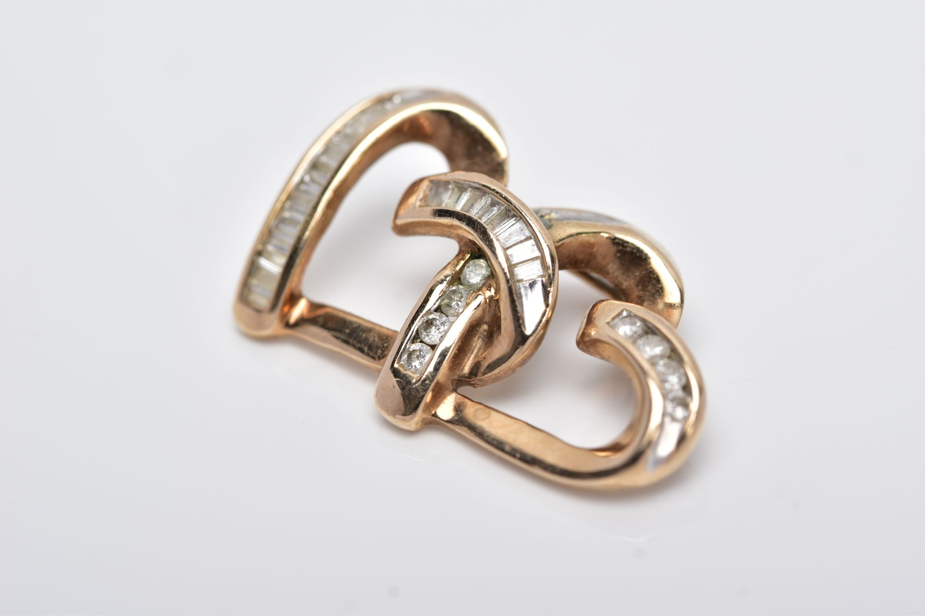 A 9CT GOLD DIAMOND PENDANT, designed as two interlocking, openwork hearts, set with tapered cut - Image 2 of 4