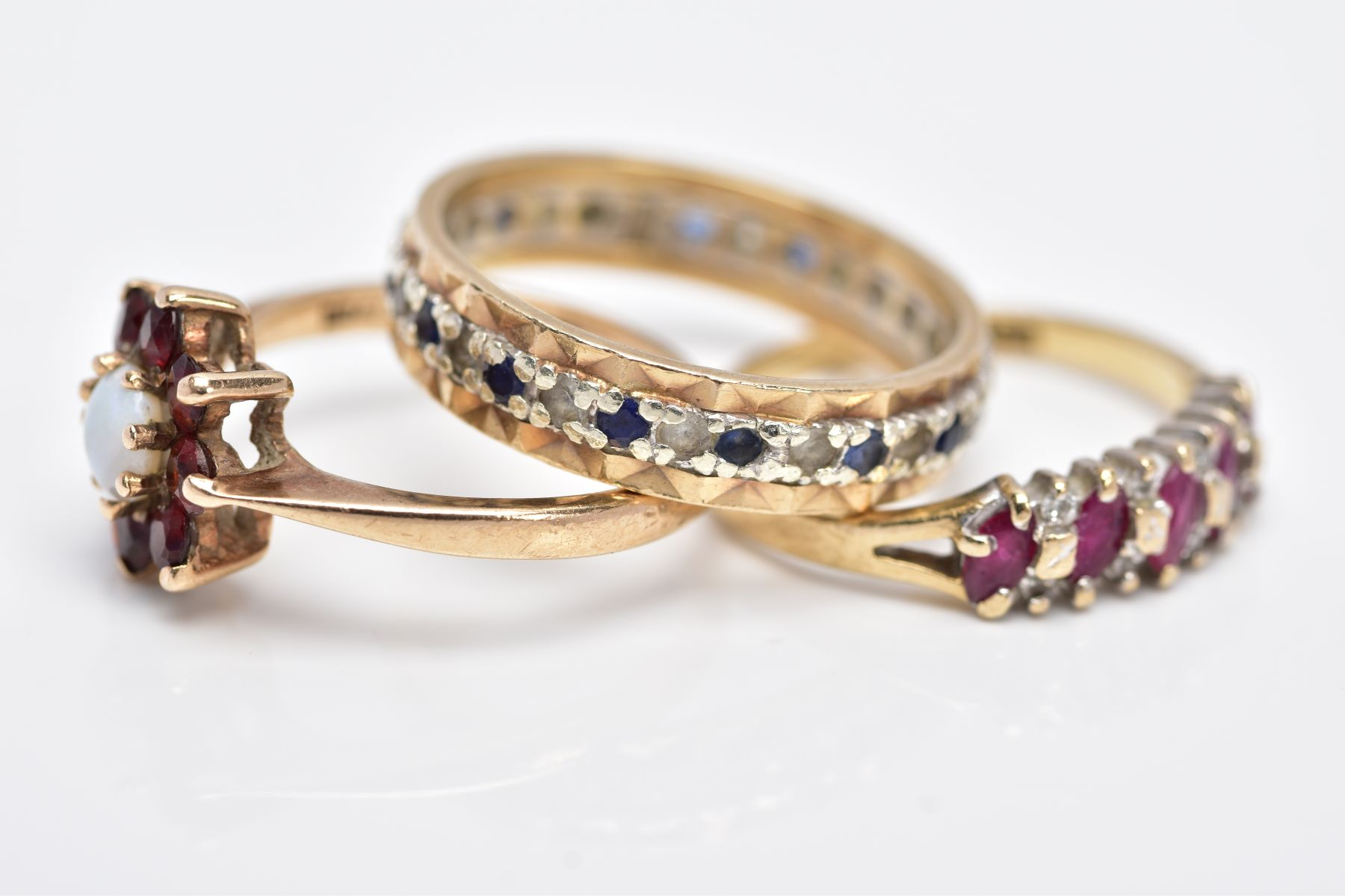 THREE 9CT GOLD GEM SET RINGS, to include a full eternity ring set with colourless spinel and blue - Image 4 of 4