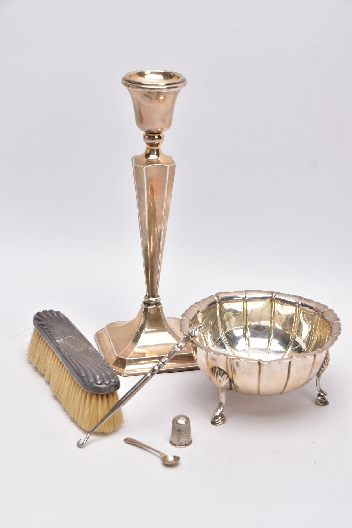A SELECTION OF SILVER AND WHITE METAL ITEMS, to include a silver, tapered column candlestick on a