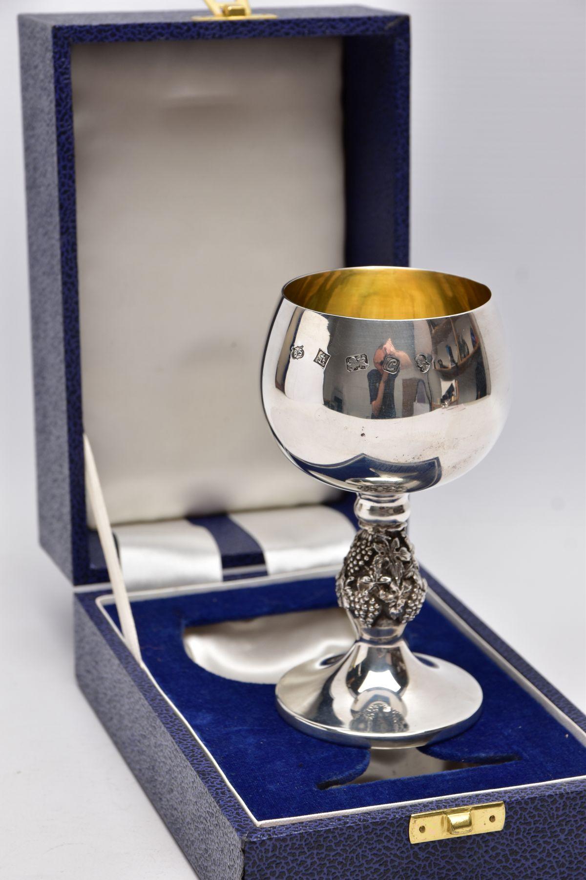 A CASED SILVER GOBLET, detailed grape vine stem, gilt interior hallmarked 'Barrowclift