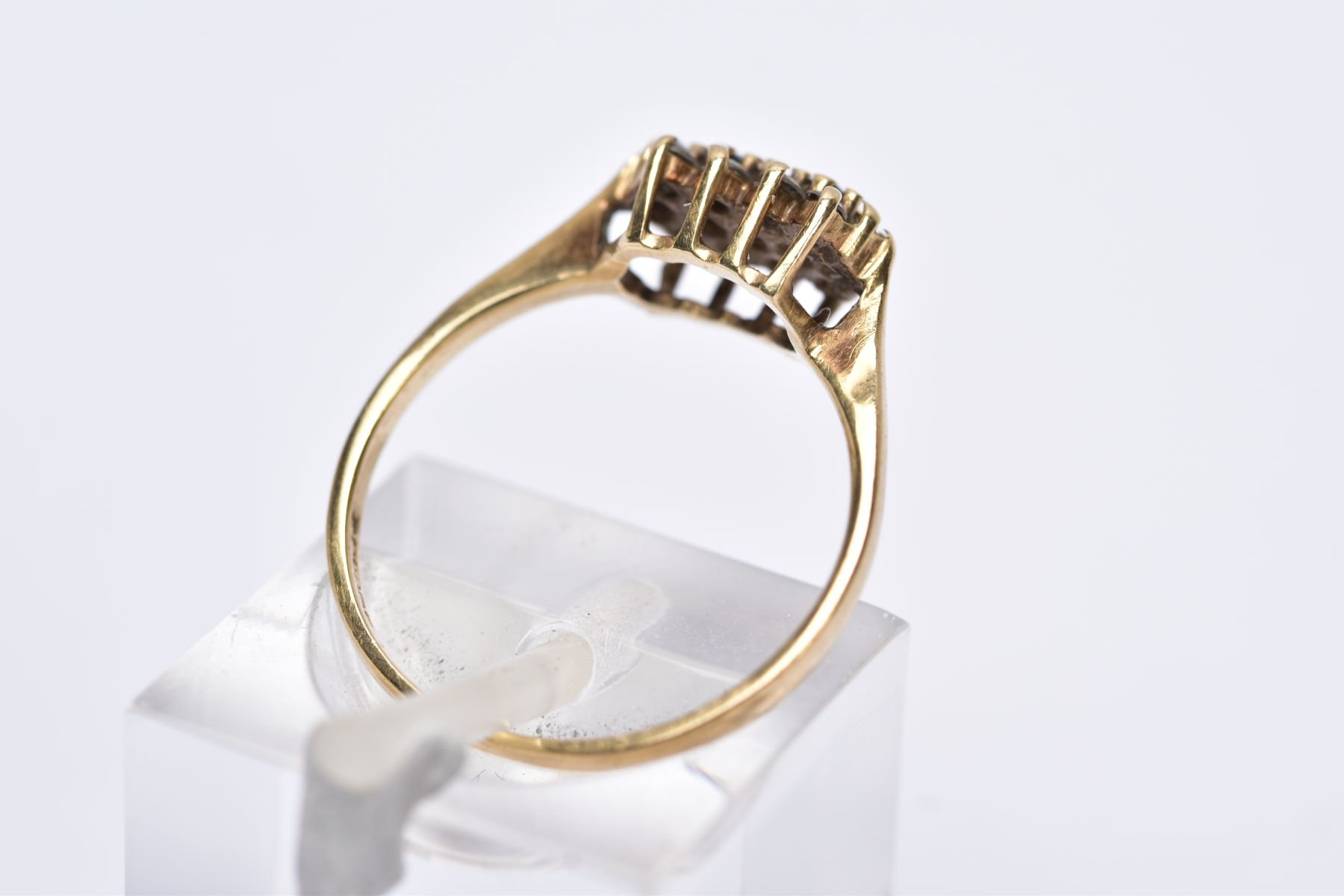 A 9CT GOLD CLUSTER RING, designed with a row of five circular cut blue sapphires, within two rows of - Image 3 of 3