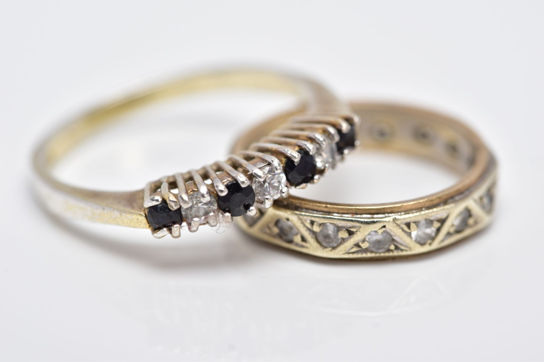 A YELLOW METAL FULL ETERNITY RING AND A SILVER GEM SET RING, the full eternity ring set with - Image 2 of 3