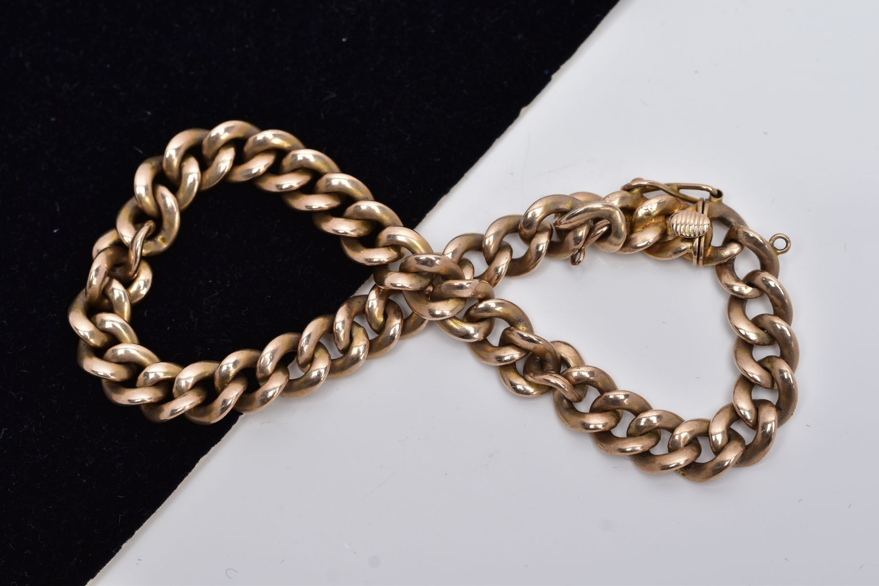 A HOLLOW CURB LINK BRACELET, measuring approximately 210mm in length, fitted to an integral box