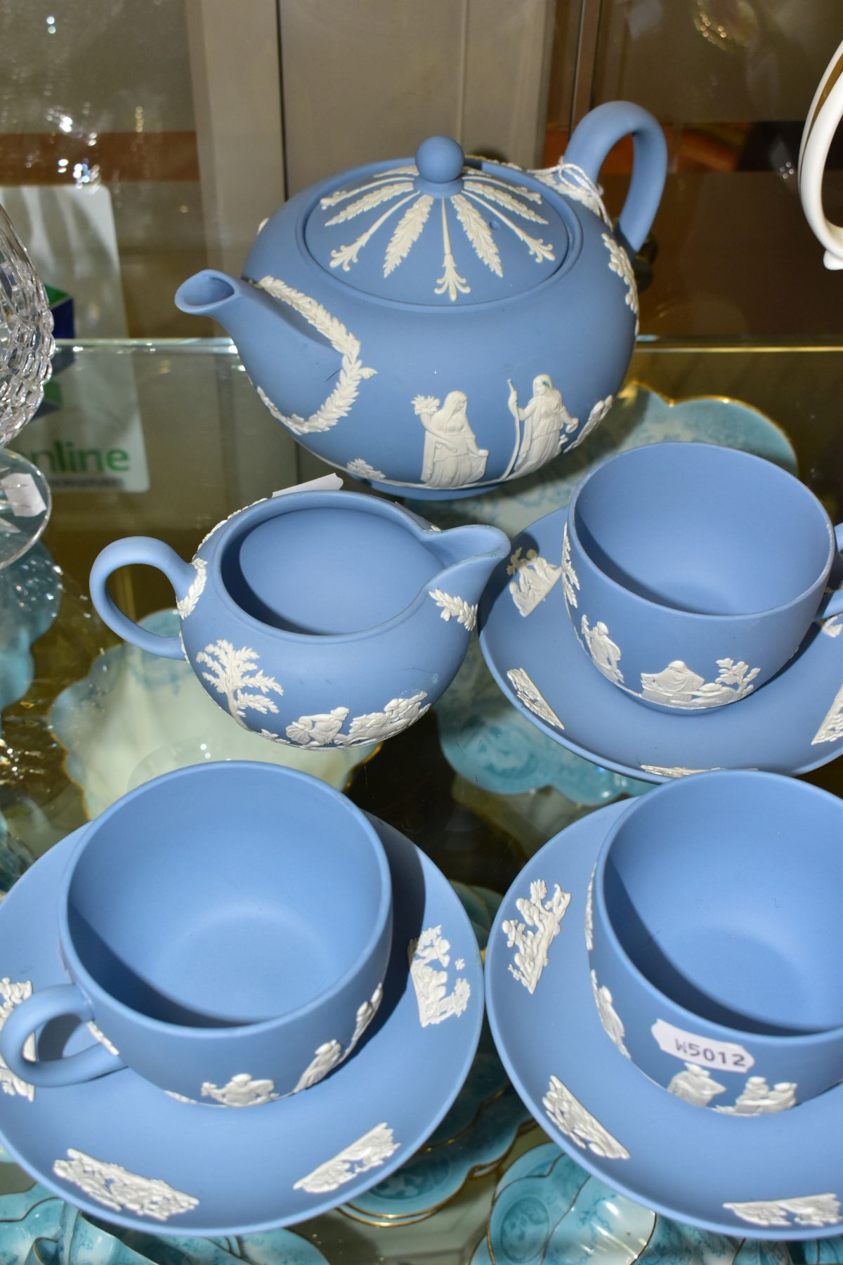 A SMALL COLLECTION OF WEDGWOOD PALE BLUE JASPERWARE, comprising a tea pot and cover and flattened - Image 5 of 6