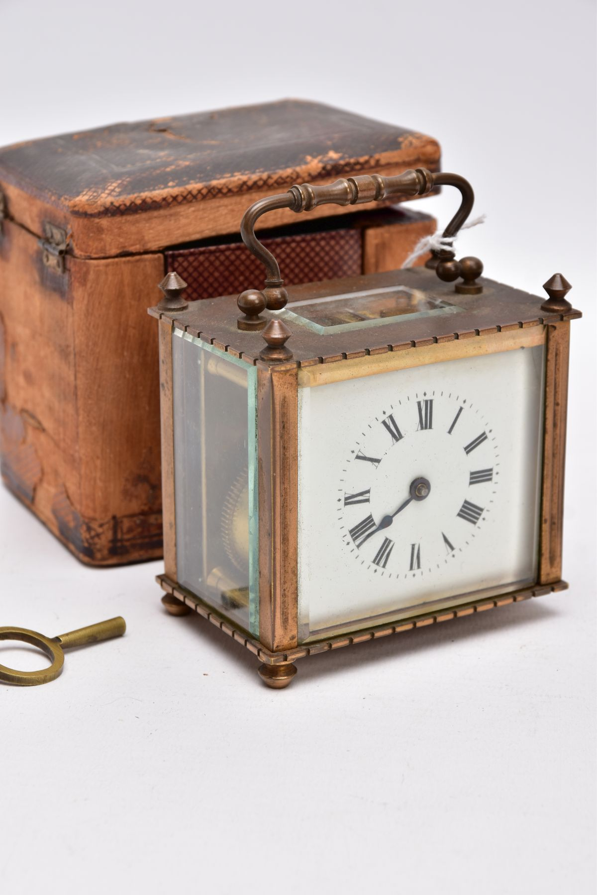 A SMALL LEATHER CASED BRASS TRAVEL CARRIAGE CLOCK, glass panels, white dial with roman numerals, - Image 3 of 8