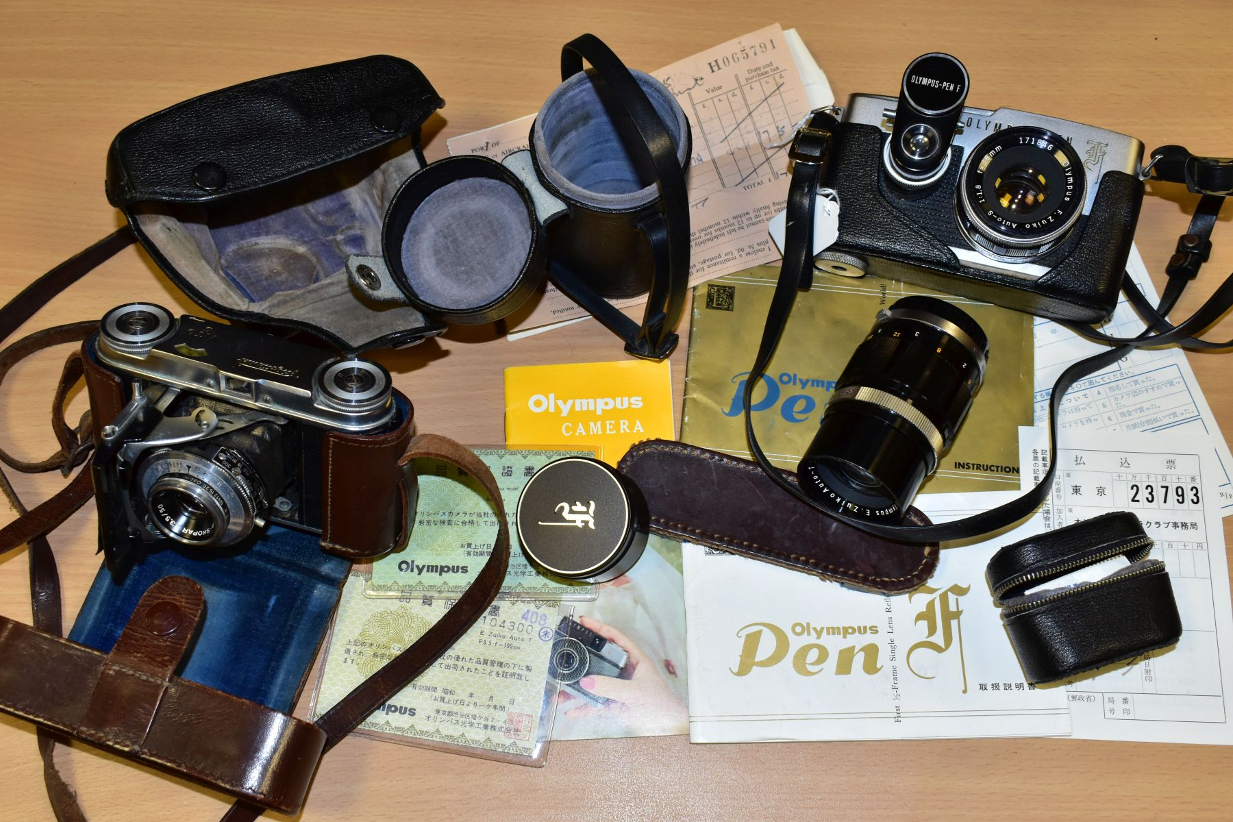 AN ORIGINAL OLYMPUS F HALF FRAME FILM CAMERA fitted with a 38mm f1.8 Olympus Zuiko lens and F T