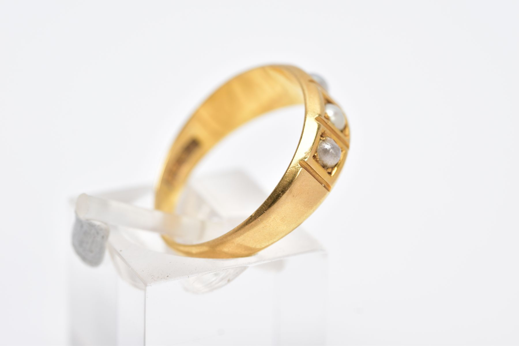 A YELLOW METAL CULTURED PEARL RING, designed with a five square section, three set with cultured - Image 3 of 3