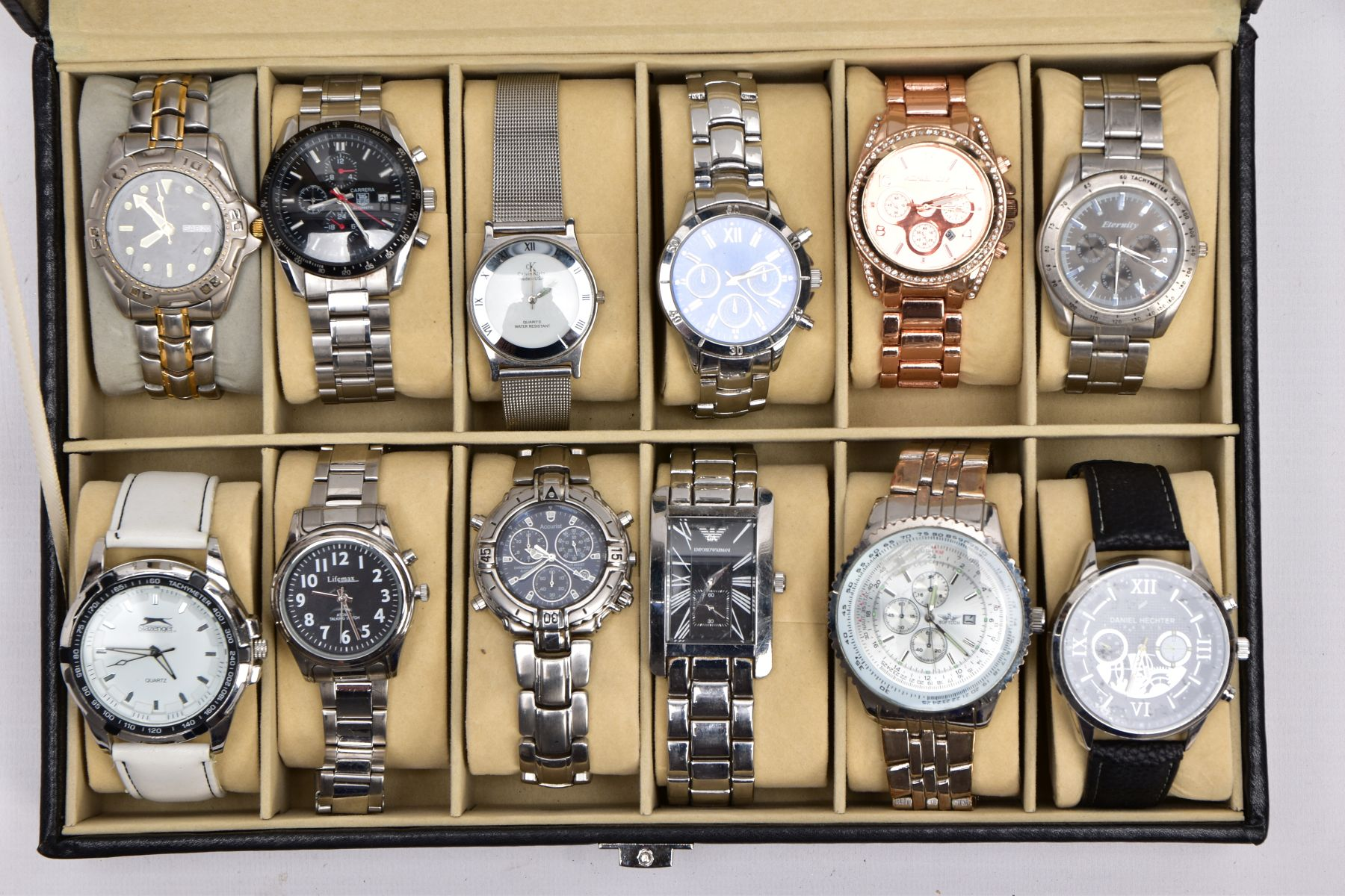 A WATCH DISPLAY CASE WITH WATCHES, a black and glass panelled watch display case with twelve watches
