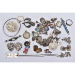 A BAG OF ASSORTED JEWELLERY, to include a white metal charm bracelet, suspending thirty-two white