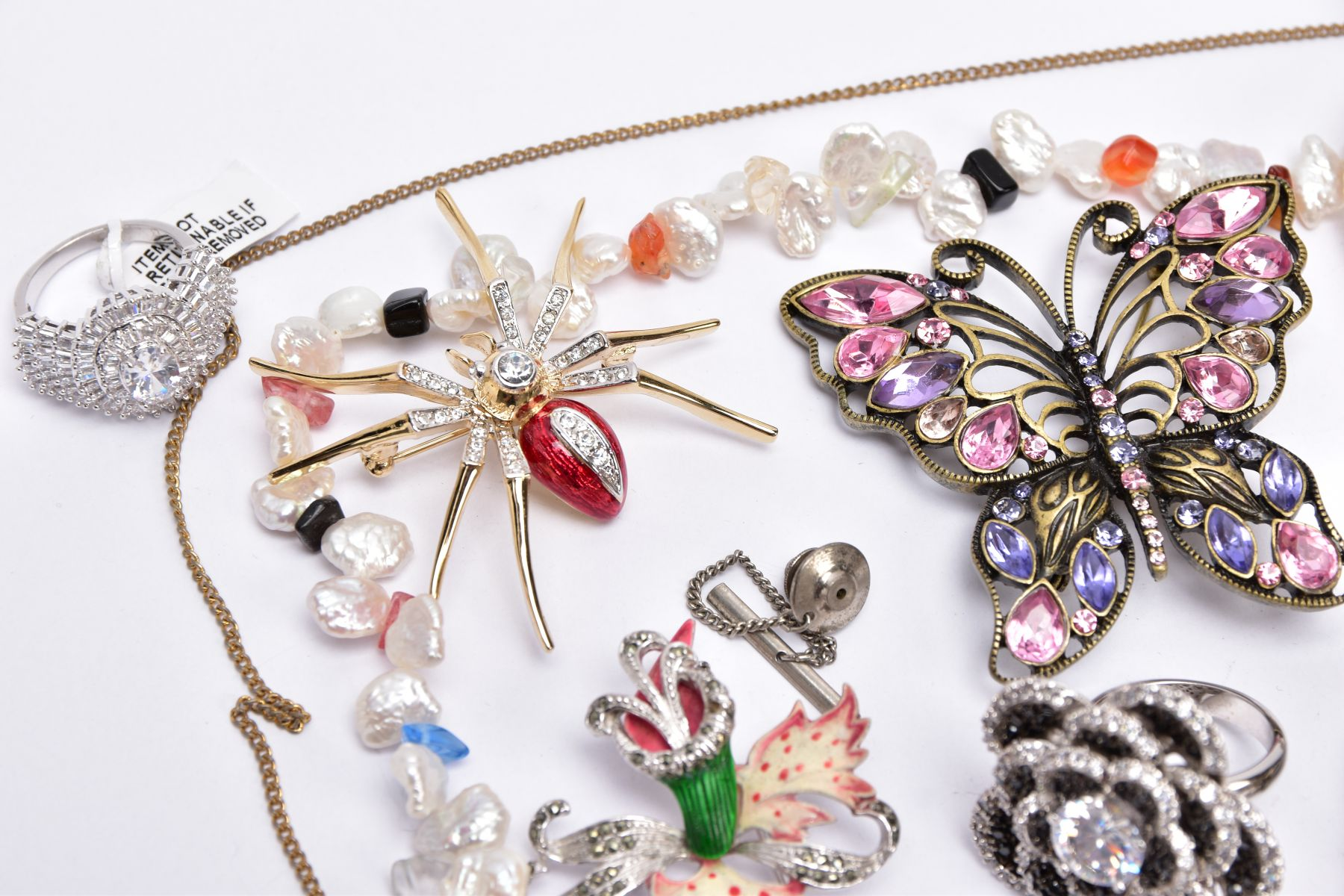 A BAG OF ASSORTED COSTUME JEWELLERY, to a yellow metal cubic zirconia set line bracelet, fitted with - Image 5 of 5