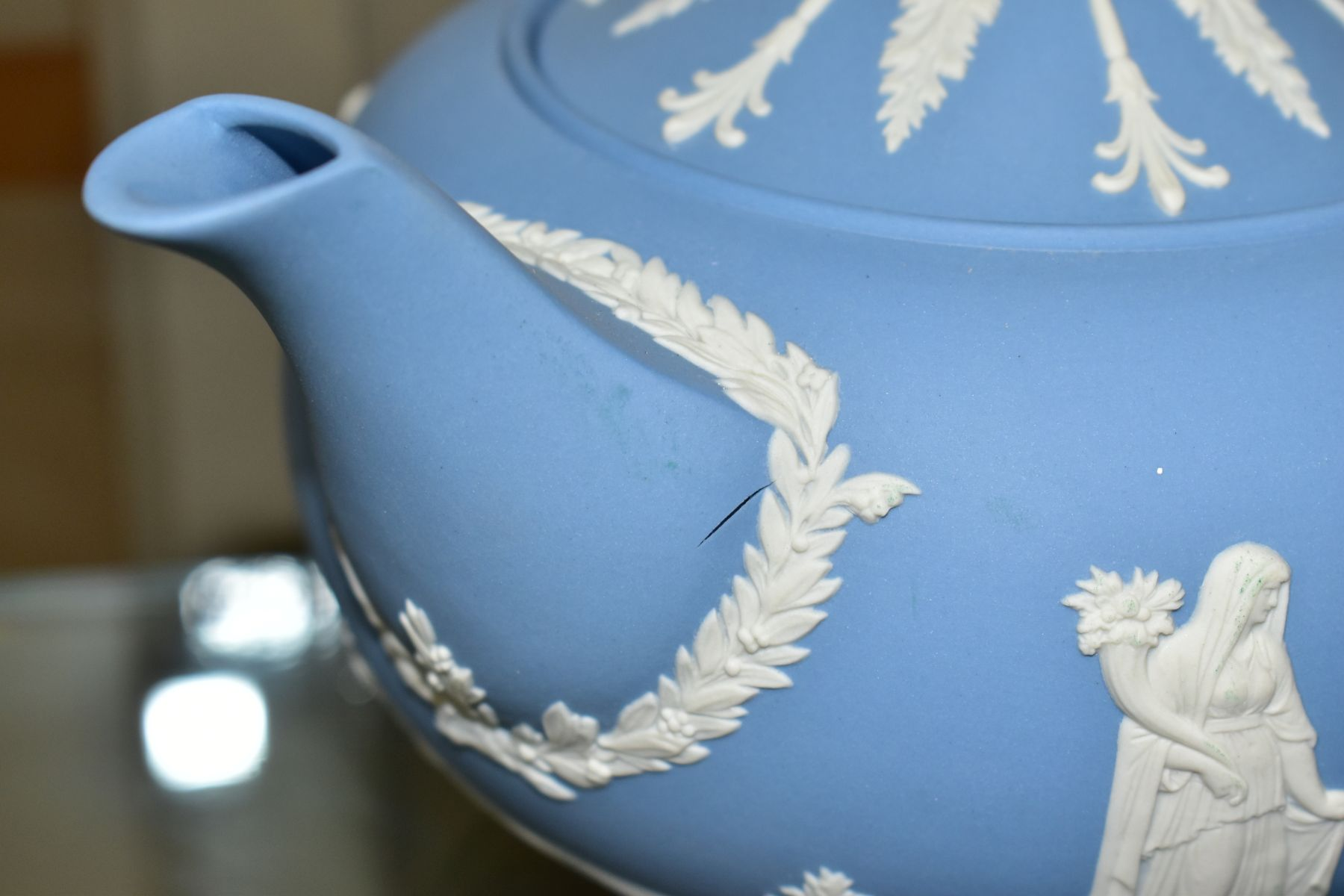 A SMALL COLLECTION OF WEDGWOOD PALE BLUE JASPERWARE, comprising a tea pot and cover and flattened - Image 6 of 6