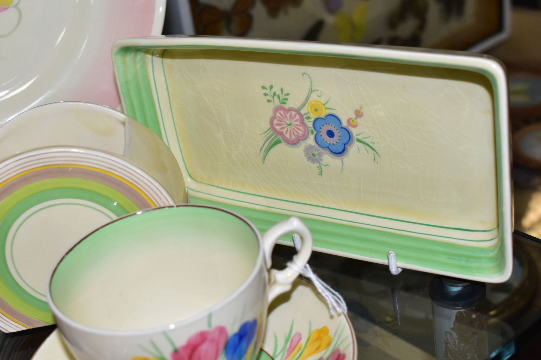 CLARICE CLIFF, comprising a Crocus pattern tea cup and saucer, backstamps for Royal Staffordshire - Image 3 of 10
