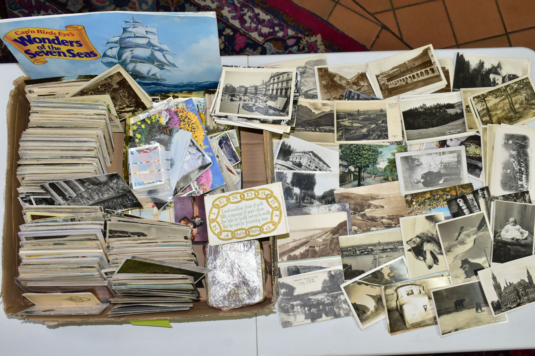 POSTCARDS, a collection of approximately one thousand postcards in one box, together with a small