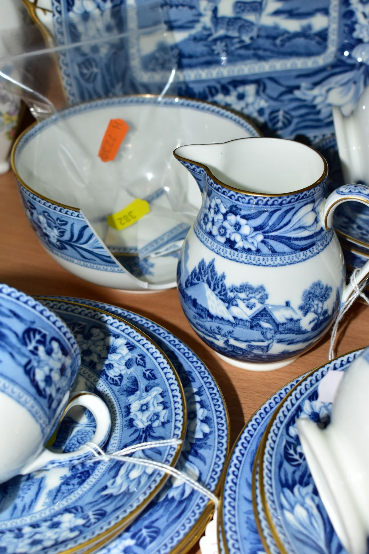 AN EARLY 20TH CENTURY WEDGWOOD BONE CHINA BLUE AND WHITE FALLOW DEER PATTERN PART TEA SET, brown - Image 4 of 6