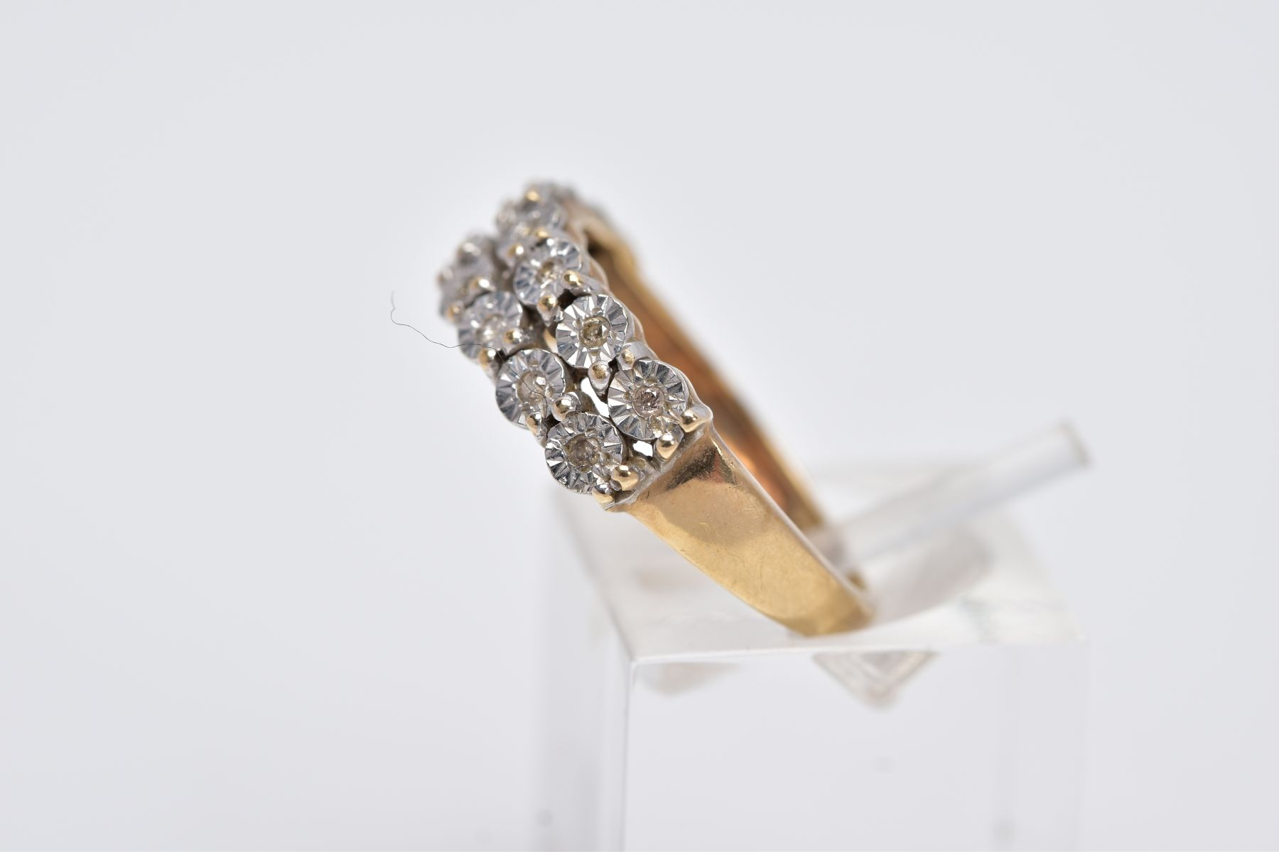 A 9CT GOLD DIAMOND RING, designed with two rows of illusion set, round brilliant cut diamonds, - Image 2 of 4