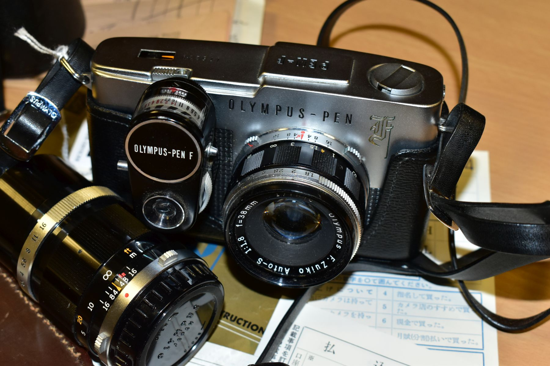 AN ORIGINAL OLYMPUS F HALF FRAME FILM CAMERA fitted with a 38mm f1.8 Olympus Zuiko lens and F T - Image 7 of 11