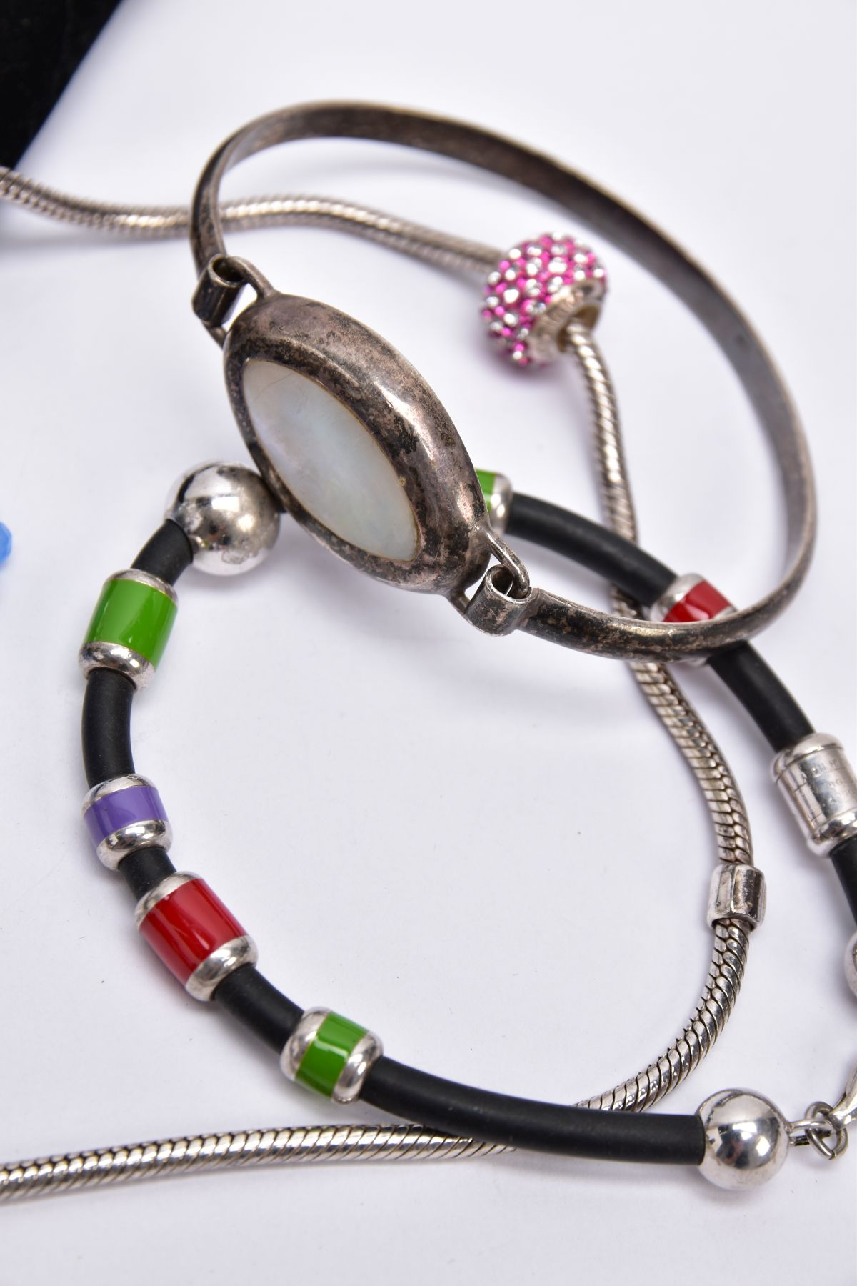 FOUR BRACELETS AND NECKLET, to include a white metal slider bracelet set with five oval cut blue - Image 2 of 4