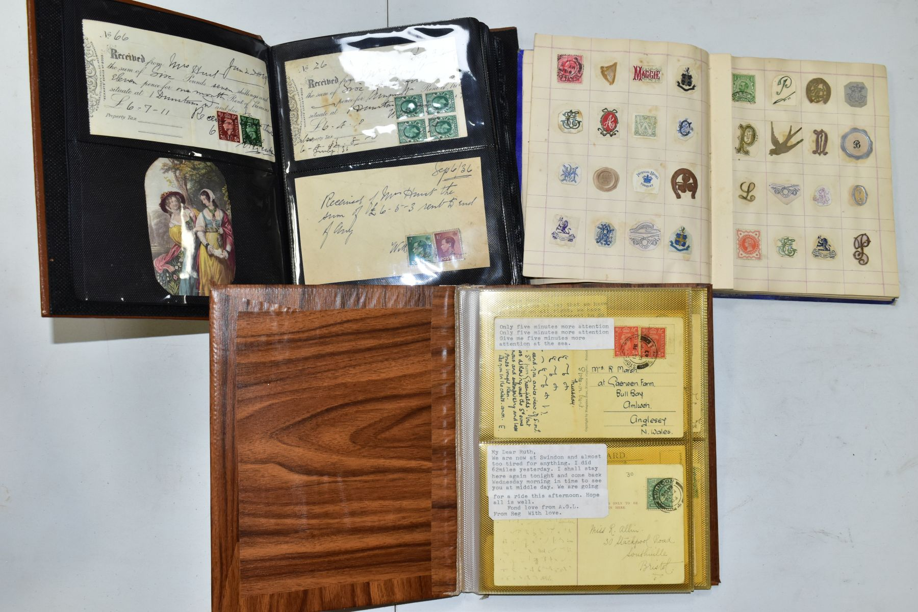 EPHEMERA AND POSTAL HISTORY, three albums containing an unusual collection of Arms and Crests,